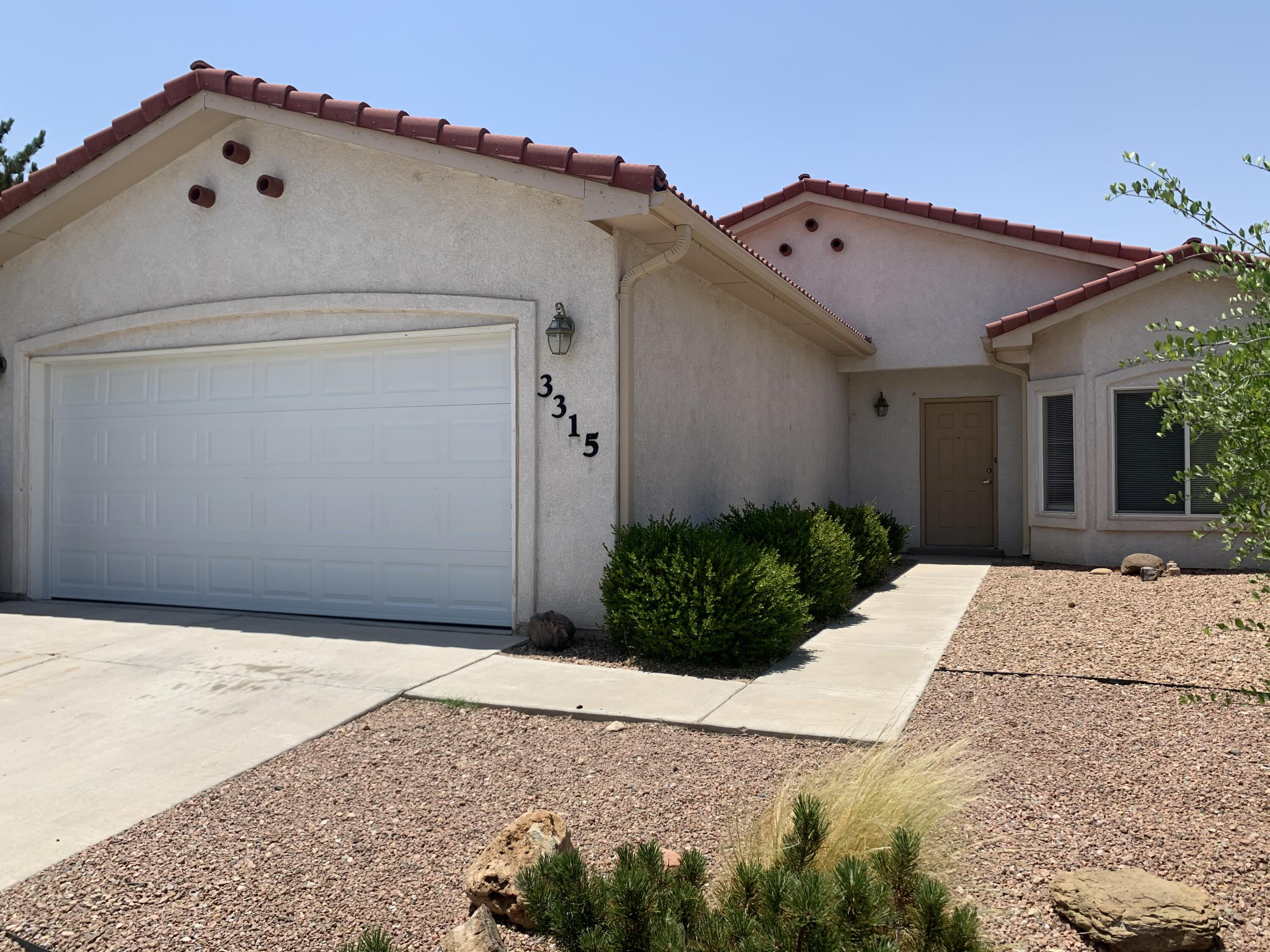 Open floor plan with nice long entryway that leads to great room with living room and kitchen. Lots of room for bar stool seating.  Dining area with lots of windows. Master bedroom has walk-in closet. Beautiful tile roof. Near community park.