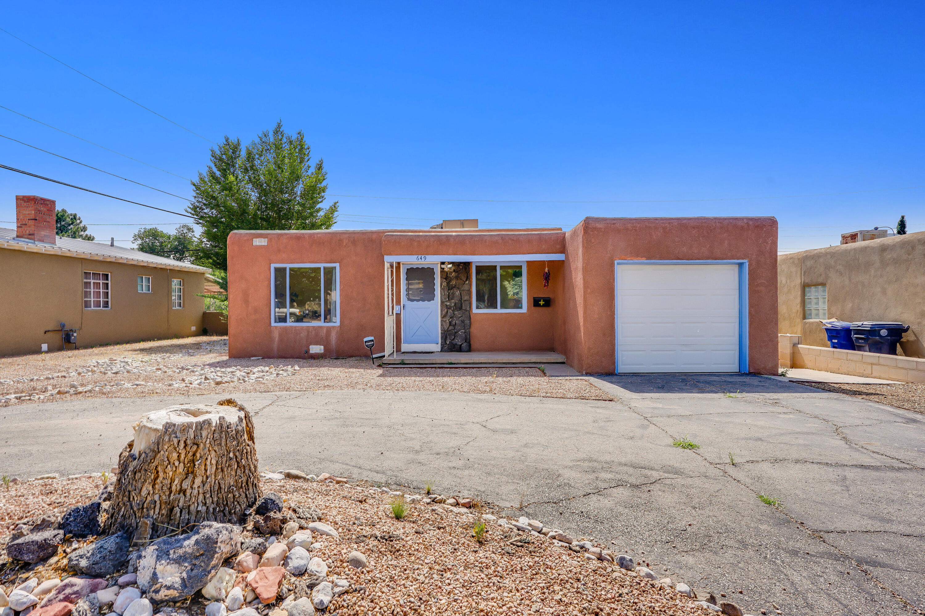 Charming details await you at 649 Monroe! Light and bright Living room with oversized windows and an office space or sitting area! Must see updated kitchen with concrete countertops and a Subway tile backsplash!  Newly remodeled bathroom with shower panel system and double sinks. Newer roof and evaporative cooler only three years old. Spacious backyard with green grass, covered Patio space, Pergola with swings, and a fire pit! The backyard also has a Vegetable garden and fruit trees, including plum, apple, and peach trees. Close to UNM and Nob Hill! Quick access to I40 and I25. Take a virtual walkthrough tour today, or schedule a private showing! Hurry, this one won't last long!