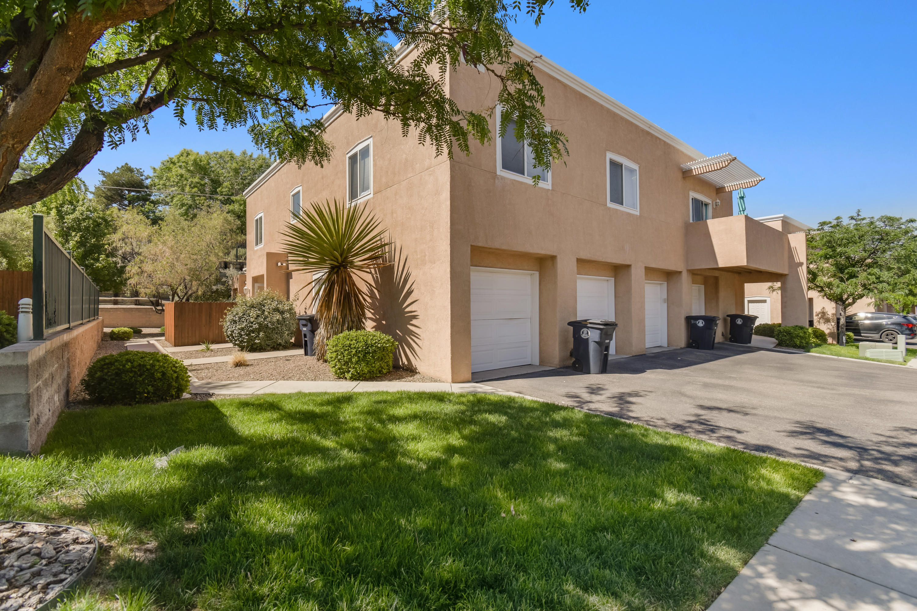 This lovely 2 bedroom condo is located in the heart of the NE heights, close to parks, restaurants, hiking trails, and night life. Condo features  new laminate flooring and carpet, new fans and window coverings with fresh paint and stain on the gate and outside trim. located in the gated Oso Park Community for added security. Don't let this one slip by!!