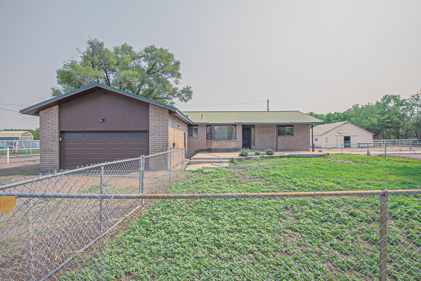 Beautiful Bosque Farms Horse Property sits on 3.2 prime acres with MRGCD irrigation!  Adequate space for all of your livestock, tractors, trailers, RV/5th wheel, and other toys!  Property features 4 stall barn with 3 connecting corrals, pasture, loft, tack room, hay storage, chicken coop, workshop/shed, open patio. Well maintained home with refrigerated air, an open split floor plan, spacious living area with fireplace, 3 bedrooms, 2 full bathrooms and a bright sunroom/hobby room. City water and sewer. Nearby amenities include a rodeo arena, biking/jogging/riding trails, library, community center, tennis and basketball courts, parks schools, shopping and restaurants. Enjoy quiet country living  just minutes from Albuquerque.