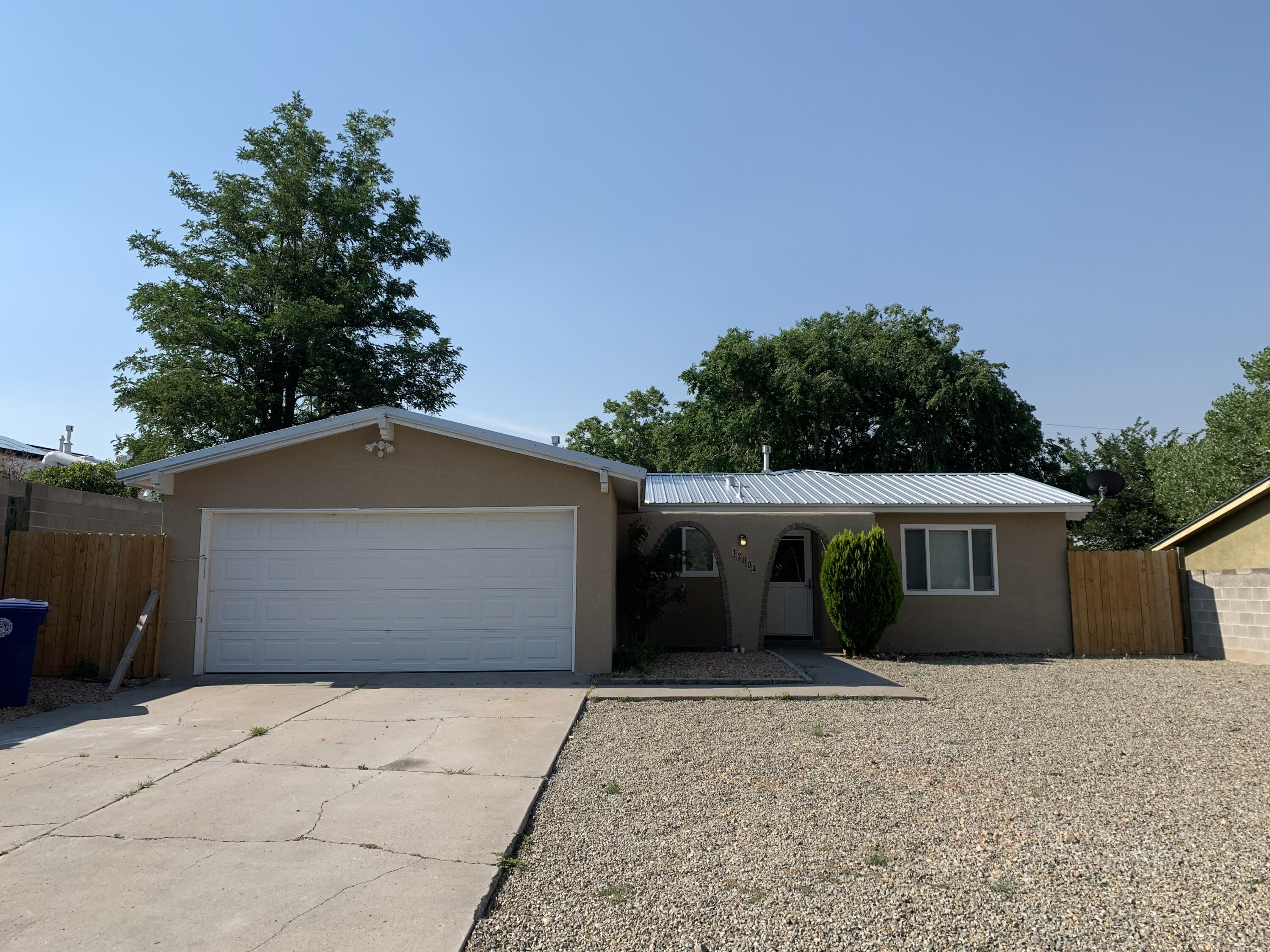 Move in ready in the NE Heights.  Single Story, 3 bedroom, 1.75/ba, 2 Car Garage with 2 living areas.  Just over 2 year old Metal roof and HWH. Nicely landscaped F&B yards.   All appliances stay including W/D.  Located directly across the street from Bianchetti Park.