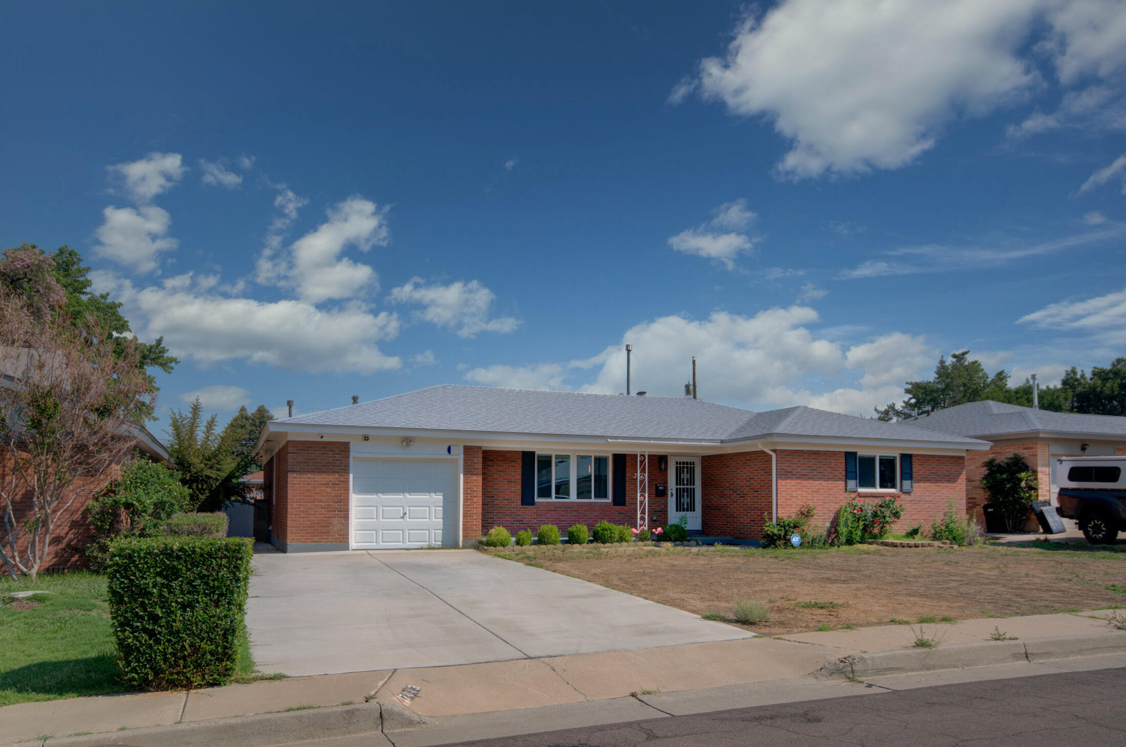 Great location, updated & move in ready.  The perfect 3. Amazing quality of life. A short stroll to Taylor Park, Winrock/Coronado, Trader Joes, ABQ Uptown, theater, library, & restaurants & easy access to I40. This wonderfully appointed brick home offers 3 bdrms, 2 baths, beautiful kitchen, living room and family room w fireplace, laundry room addition, newer flooring, windows, refrigerated air, freshly painted throughout, ceiling fans, water heater, small garage for storage or small vehicle, and newer driveway. All those upgrades and it's original 1956 charm, with refinished hardwood floors, covered patio, large backyard to build your own sanctuary and entertainment areas. They just don't build homes like this anymore. And a cul-du-sac street, yay! All offers reviewed after Monday 12p.