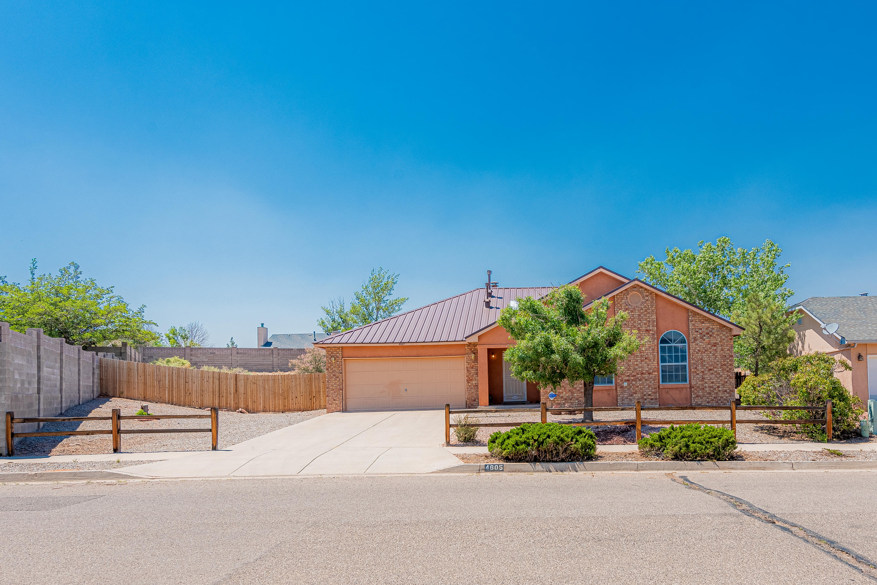 Welcome home to this Spectacular 4 bed 2 bath located in Enchanted Hills. This Gorgeous home offers a beautiful backsplash in the kitchen with matching countertops, pantry and tile in all the wet spots. Other recent upgrades include a new roof (2019) and new water heater(2019). You'll appreciate the massive backyard, just under a half acre. Perfect for entertaining with its covered patio and all the space you'll need for a basketball court, volleyball, horse shoes, cornhole etc. With backyard access, you can also park any toys you desire. Move in ready homes are moving fast so if you can only see a few homes makes sure this one is on your list!!