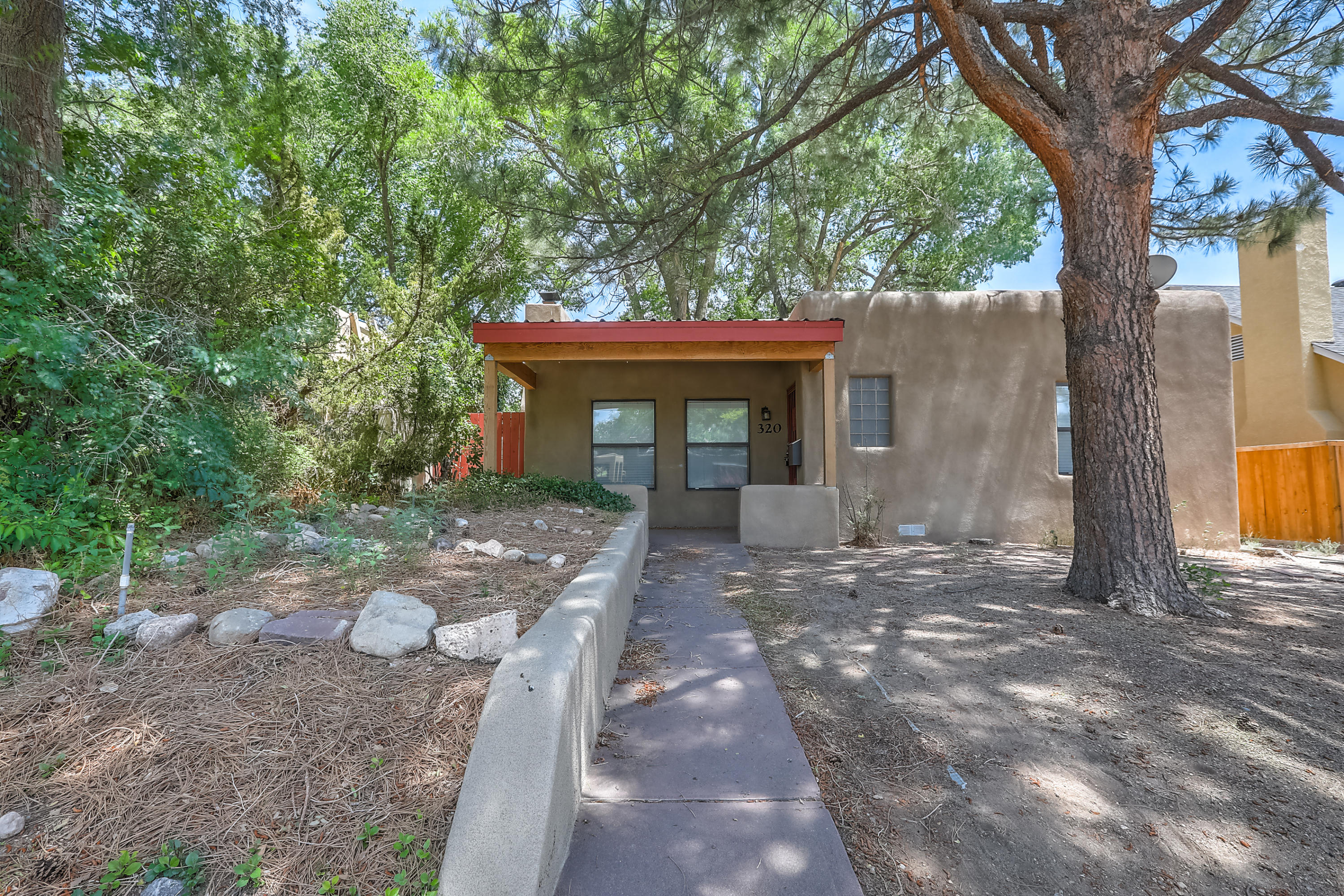 Super adorable bungalow close to UNM is bright and open! Beautiful wood flooring and natural light throughout thanks to ample windows. Large, mature shade trees in front and back. Spacious backyard has gate access and detached one car garage.  Convenient location and abundant charm - it's an opportunity you can't pass up!