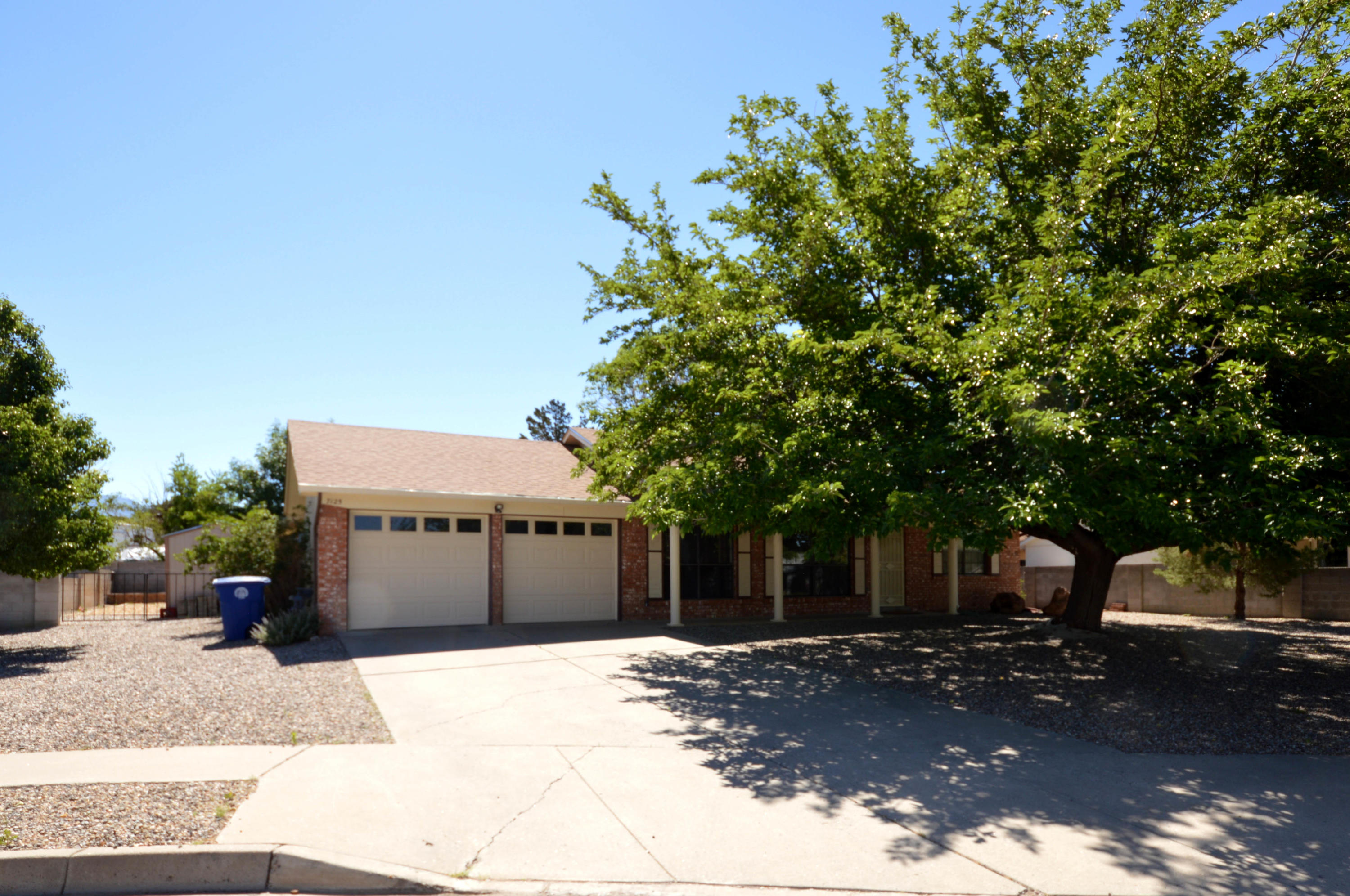 Located on a quiet cul-de-sac, this home has a spacious open floor plan with a large greatroom, kitchen with breakfast nook, dining room, 3 bedrooms and 2 baths. Home comes complete with all appliances including microwave, refrigerator and washer and dryer. There is an attached heated and cooled workshop/studio/rec room/office with counter cabinets and sink. Large backyard is highlighted by a covered patio, storage shed with power and gated backyard access. Home needs a little finish work including flooring throughout and wall covering in master bathroom.