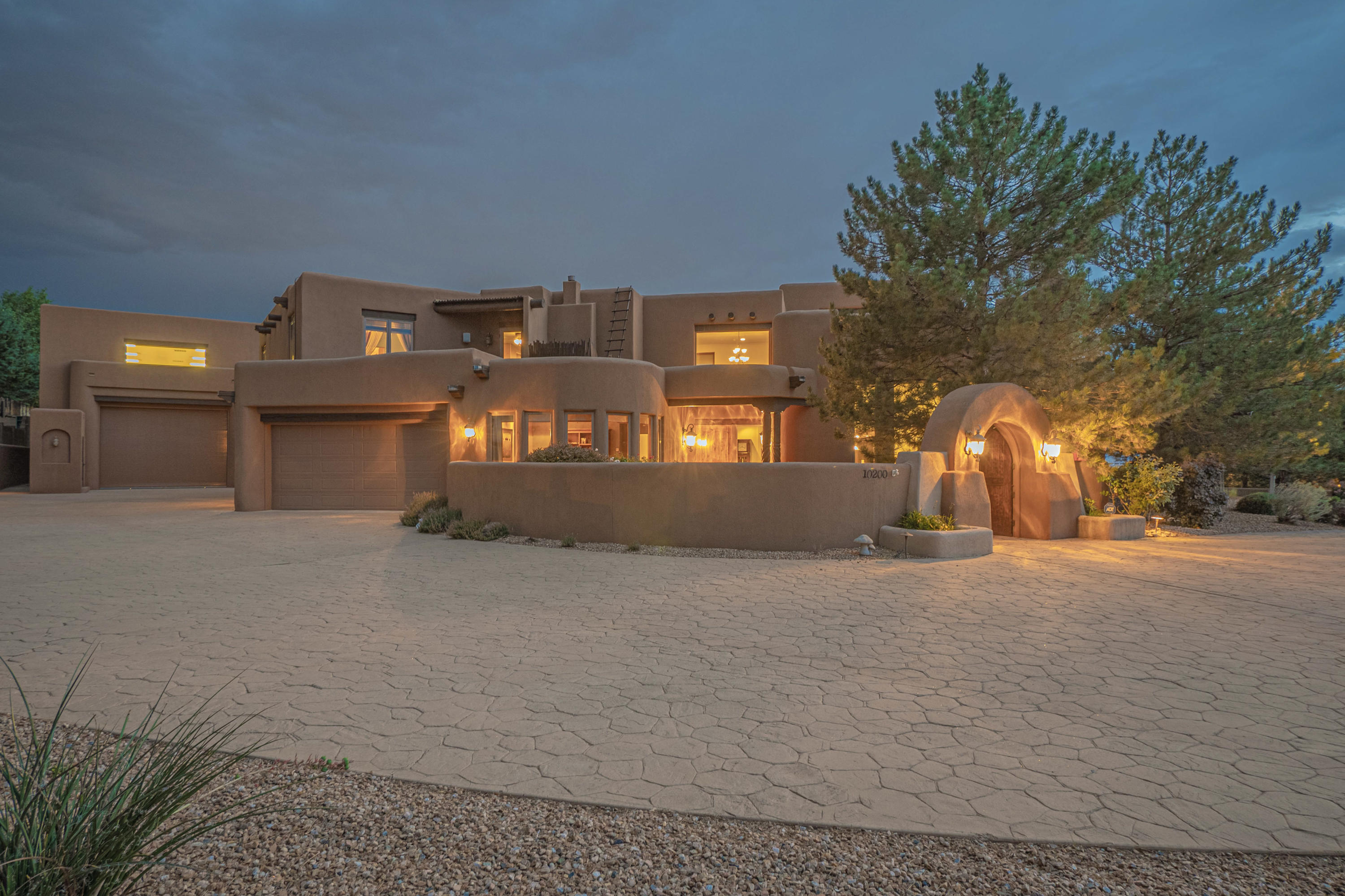 Heaven in North ABQ Acres! Spectacular Custom Built home, designed by Eric Spurlock. Enter through private courtyard. The flowing floorplan offers soaring herring bone beamed ceilings and expansive great room makes this a wonderful home for entertaining. Chef's kitchen offers all Viking Appliances, island with gas cooktop, opens to a Morning room with Kiva Fireplace, sitting area and a breakfast nook. Also opens to an outdoor patio. Formal dinning room, with entrance to private Wine tasting room, temperature controlled, space for 100s of bottles w/racks and wine storage. Seating for conversation. Owner's suite on main level offers tray ceilings, sitting area, access to outside patio.