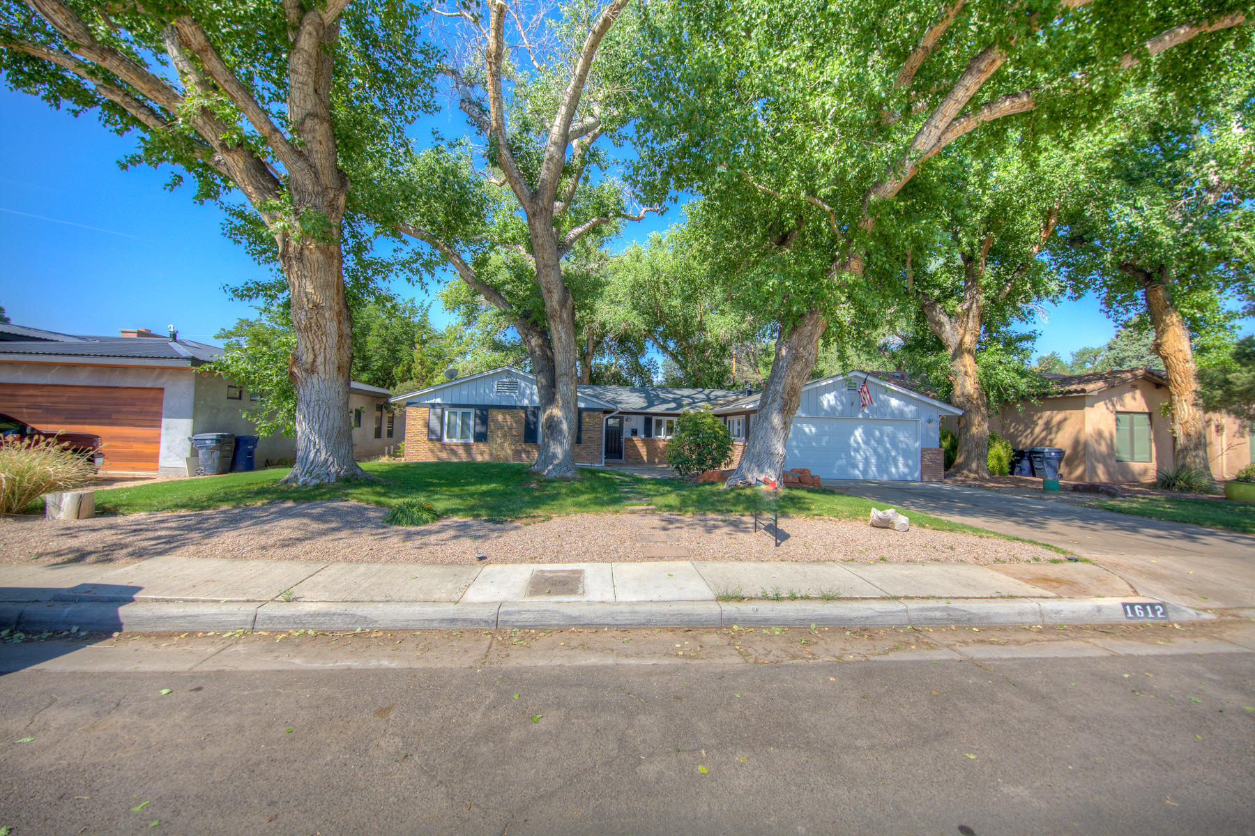 Beautiful Home in the Albuquerque Country Club neighborhood. This awesome home has two living areas, two master bedrooms! Spacious 4 bedrooms, quartz countertops, stainless steel appliances, and  refrigerated air. Come see your new home today!