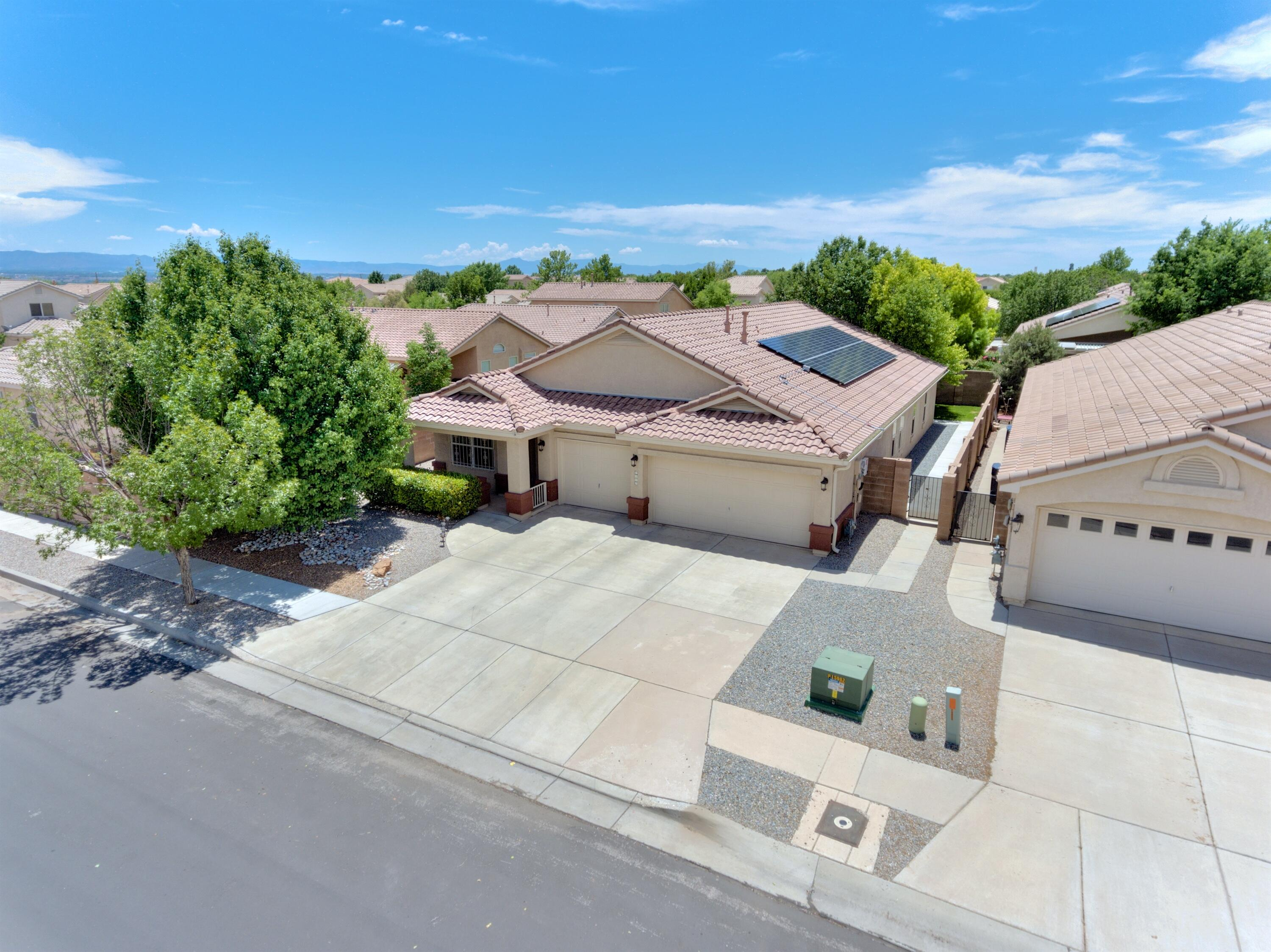 Beautiful single story home in the Story Rock neighborhood!  Pride of ownership radiates throughout the home with many updates.  The quaint country kitchen with storage galore, stainless steel appliances, BIG island, farm sink and HUGE pantry will make you say, ''Wow!''  The relaxing and nicely landscaped backyard with patio, shade tree and grass allows for some much needed R & R.  Stay cool this summer with the refrigerated air that is powered by recently installed solar panels to help with electric costs!  Enjoy the extra storage with the 3rd garage bay and attic space.  Located within the Volcano Vista school district and conveniently located for easy highway access and shopping.  The home yearns to please!  Don't delay, view today!