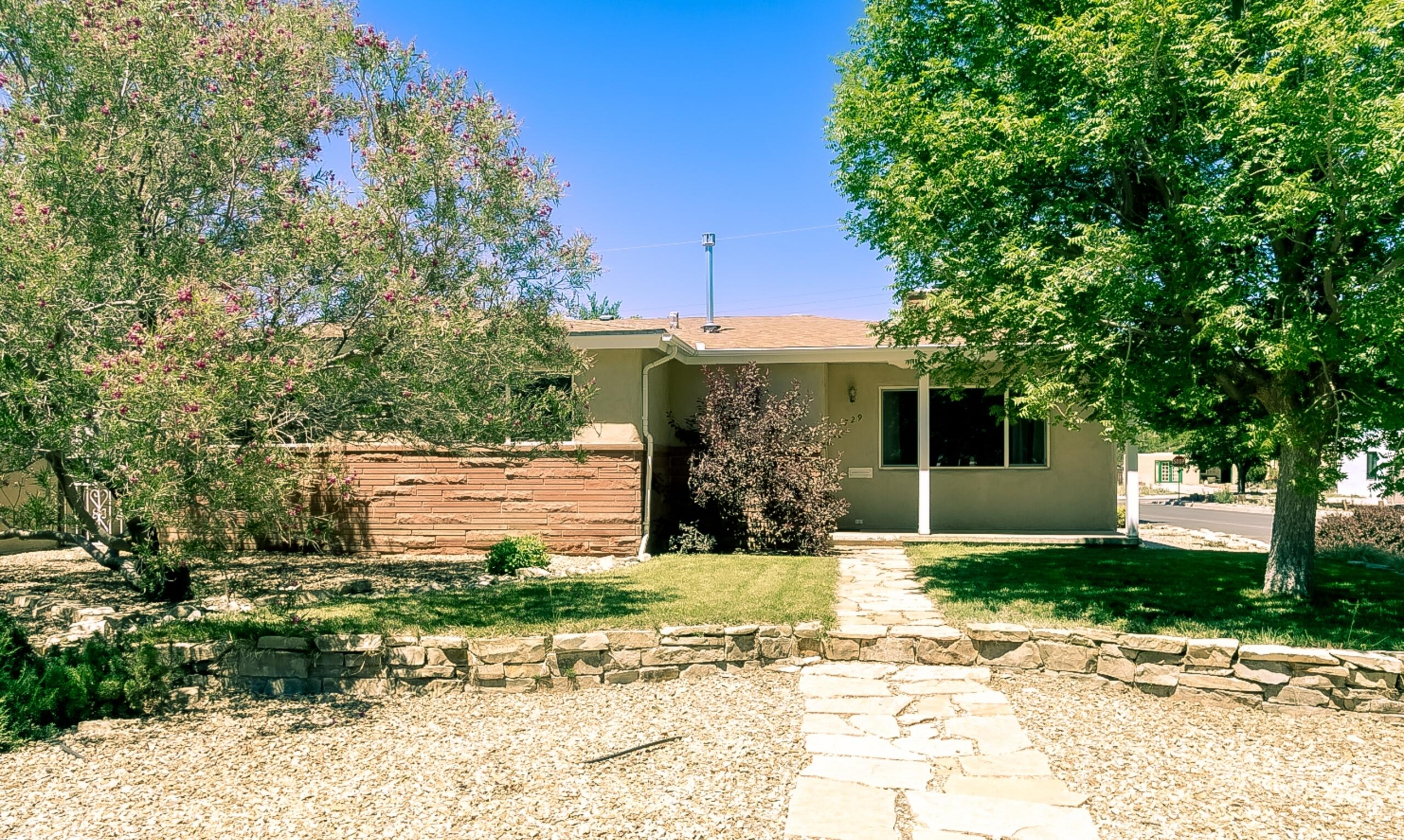Amazing 1-level mid-century ranch-style home on a beautifully landscaped corner lot directly across from Marion Fox Park! Inside finds a super floorplan w/oak floors, sandstone gaslog fireplace, sandstone windowsills, thermal windows & more. Living & dining rooms. Modern kitchen w/poured concrete counters & stainless-steel appliances (fridge incl!), 2 updated baths & 3 big bedrooms incl huge master suite w/walk-in closet. Laundry room w/extra storage & stacked washer/dryer incl. Refrig air, solar electric & on-demand hot water w/solar assist. Front entry porch. Wood deck overlooks landscaped backyard. Two car garage + extra off-street parking. Newer stucco with 2-inch foam insulation + sandstone veneer. Auto drip/irrigation. Located on Bike Blvd!