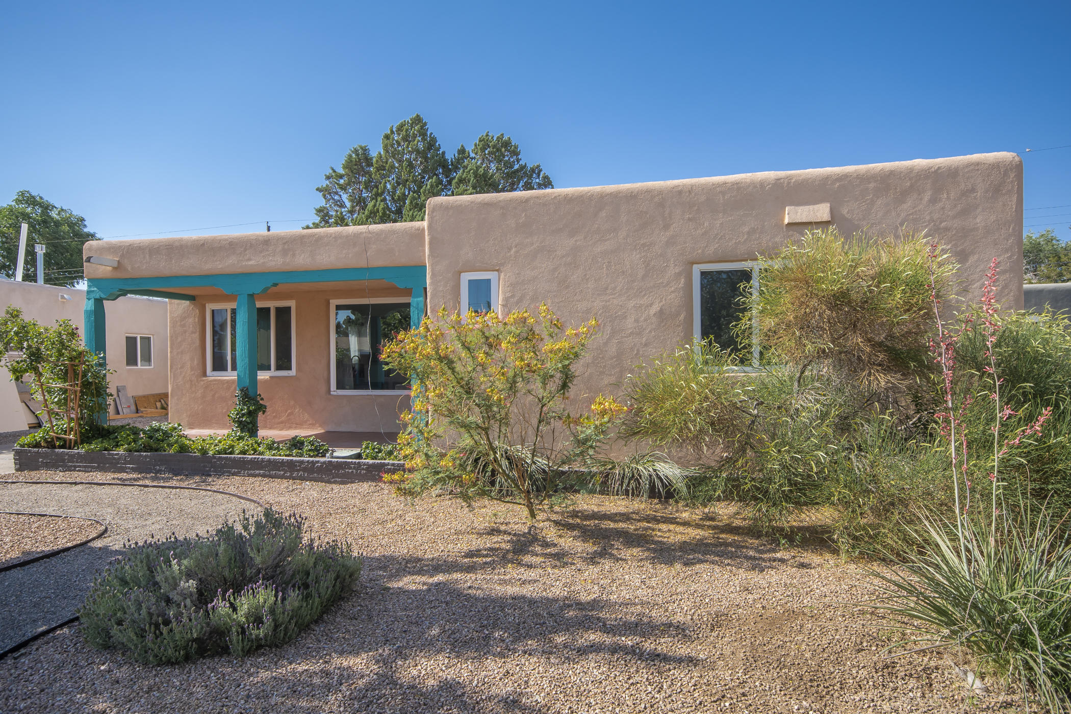 You'll love this quintessential South UNM area casa, featuring the original 3 bedroom, 1 bath, with a spacious  addition in the back  w/ 3/4 bath and wood burning fireplace.  Hard floor surfaces throughout.  Open kitchen to main living area  is fully updated with beautiful cabinets, hard surface countertops, and SS appliances.  Original full bath is updated with custom tile and contemporary finishes.  New stucco, newer windows, recent full roof tune.  Private backyard features a nice pergola just off the rear living area.  Close to Sandia Labs, Kirkland AFB, w/ easy access to the Sunport.  Walk to Michael Thomas coffee shop!  A lovely neighborhood and a nice place to call home :)