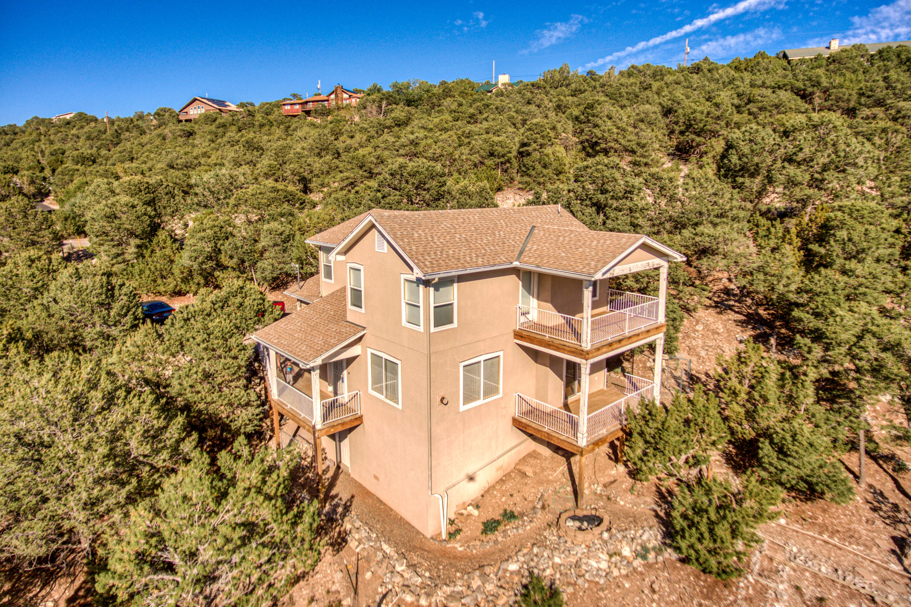 Welcome to Tablazan! This home has amazing views from the living room, dining room and master bedroom. Enjoy sitting on your own private deck to enjoy star gazing. The kitchen has plenty of cabinets for all your goodies and bar for extra seating. The half bath downstairs makes it convenient for your guests. The bedrooms are all upstairs with a full bath in the hall. The Master Bedroom is complete with a walk in closet and a huge tub and seperate shower in the master bath. Make this home yours before its too late!