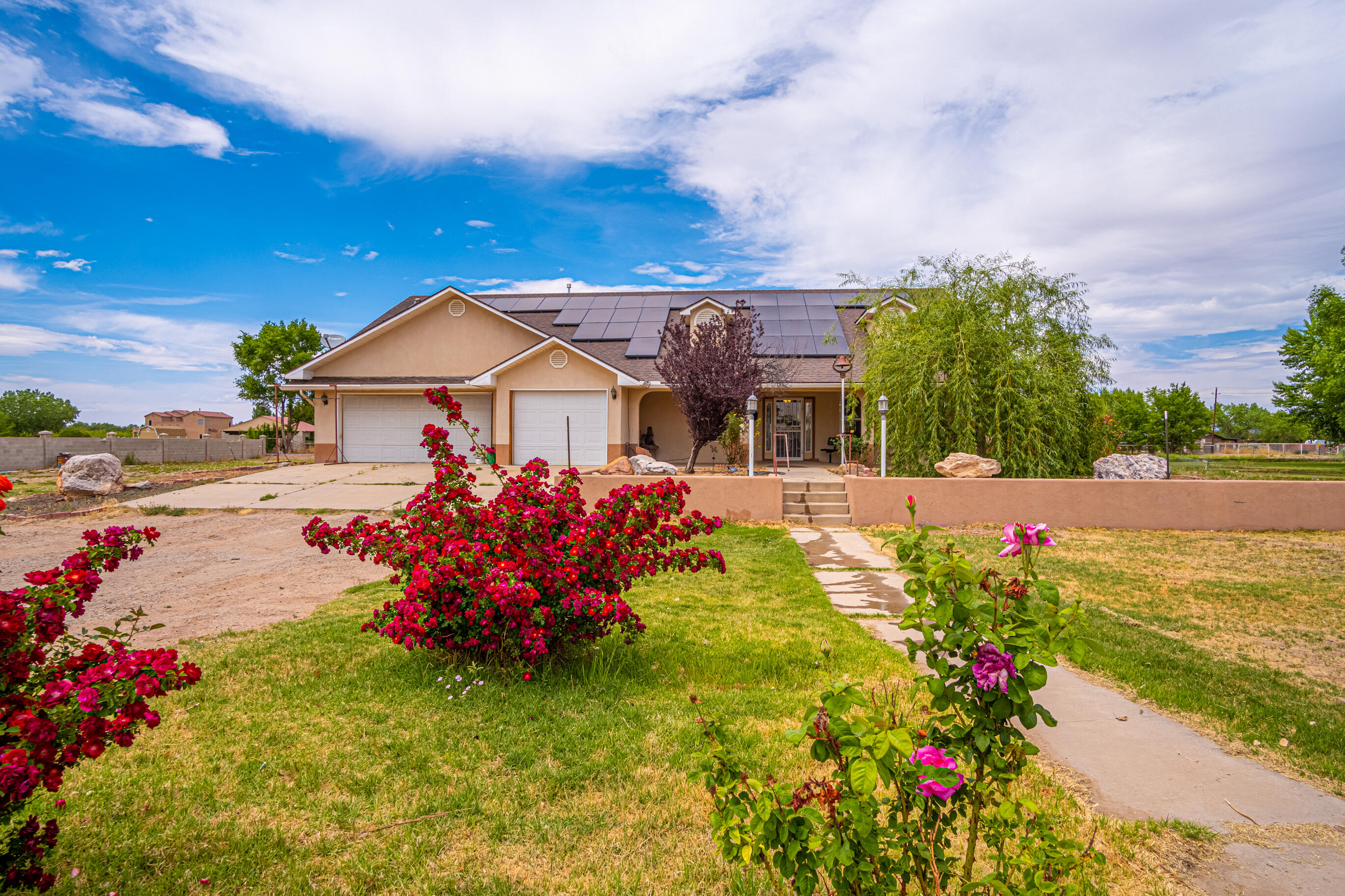 1.56 IRRIGATED ACRES!! This home has so much to offer, the master bedroom has a huge walk-in closet leading into an oversized bathroom with garden tub and separate shower. Also included is a 3 car garage with plenty of space for more toys.  The open kitchen is perfect for gathering with 2 stoves.