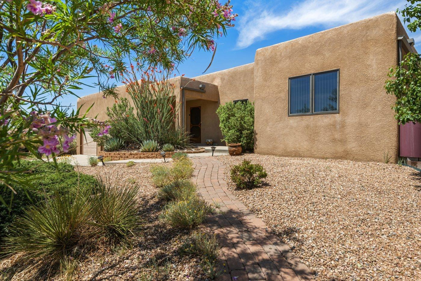 Welcome to this wonderful single level home on .35 acres located in the sought-after Sandia Foothills. The large chef's kitchen is an integral part of the open floor plan concept which connects to the great room. The kitchen features an in-wall oven, an abundance of cabinets, generous countertop space, an island and seating to enjoy the space. With 3 bedroom plus an office/study there is lots of space in this light and bright home. Owner's bedroom and office at opposite ends of the house from guest bedrooms add wonderful privacy. The owner's bedroom has a large walk-in closet, separate tub and shower. Enjoy your summer evenings under your patio large enough for entertaining or cozy enough for yourself. Very private and beautifully landscaped. Additional features of this property are the