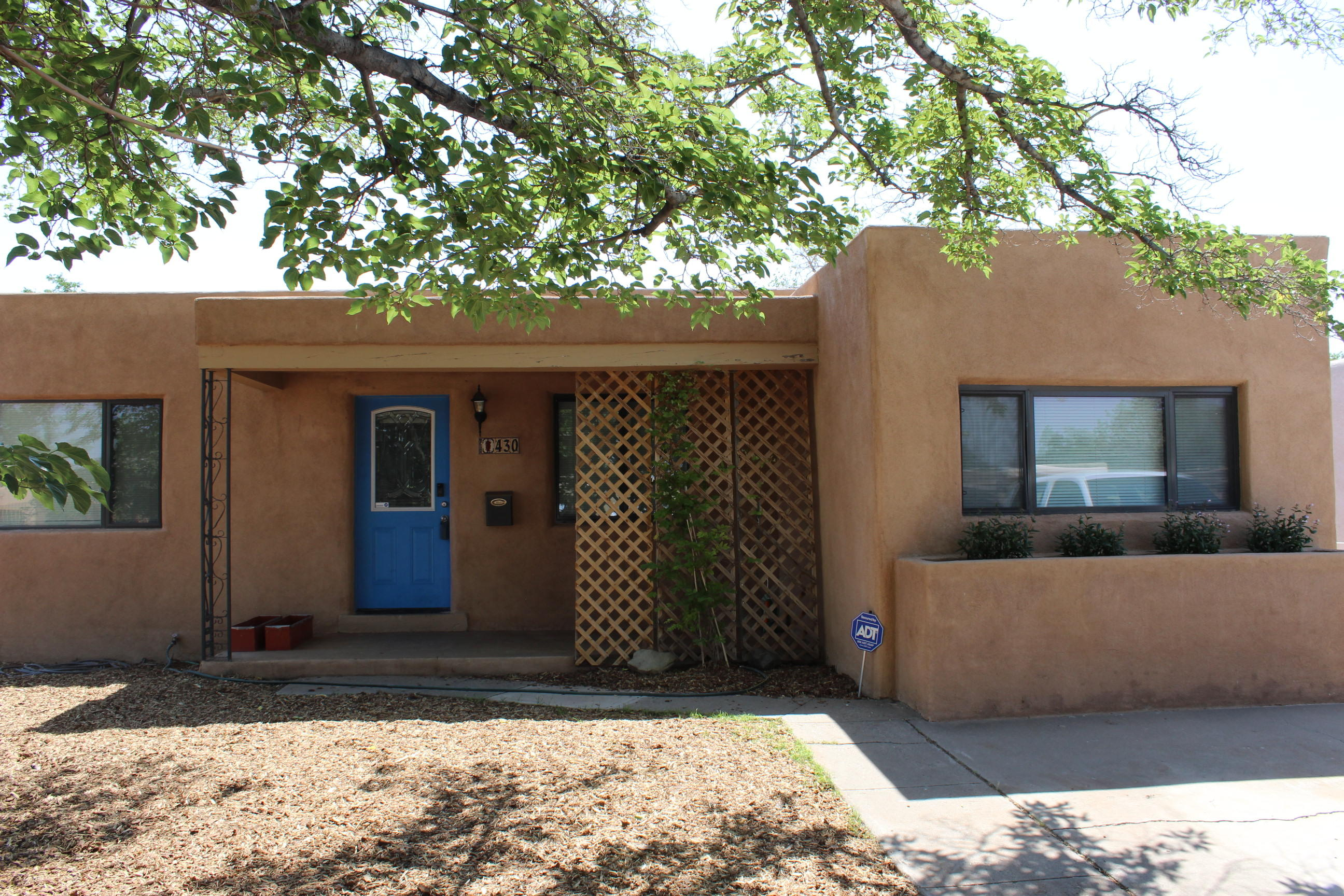 Beautifully maintained home located in the heart of Albuquerque. Gorgeous Kitchen with stainless steel appliances, concrete countertops and knotty pine cabinets. Four bedrooms, three baths, a large laundry room, and an office or fifth bedroom. New evaporative cooler, fresh paint, pending new carpet install, all of this on a large city lot.