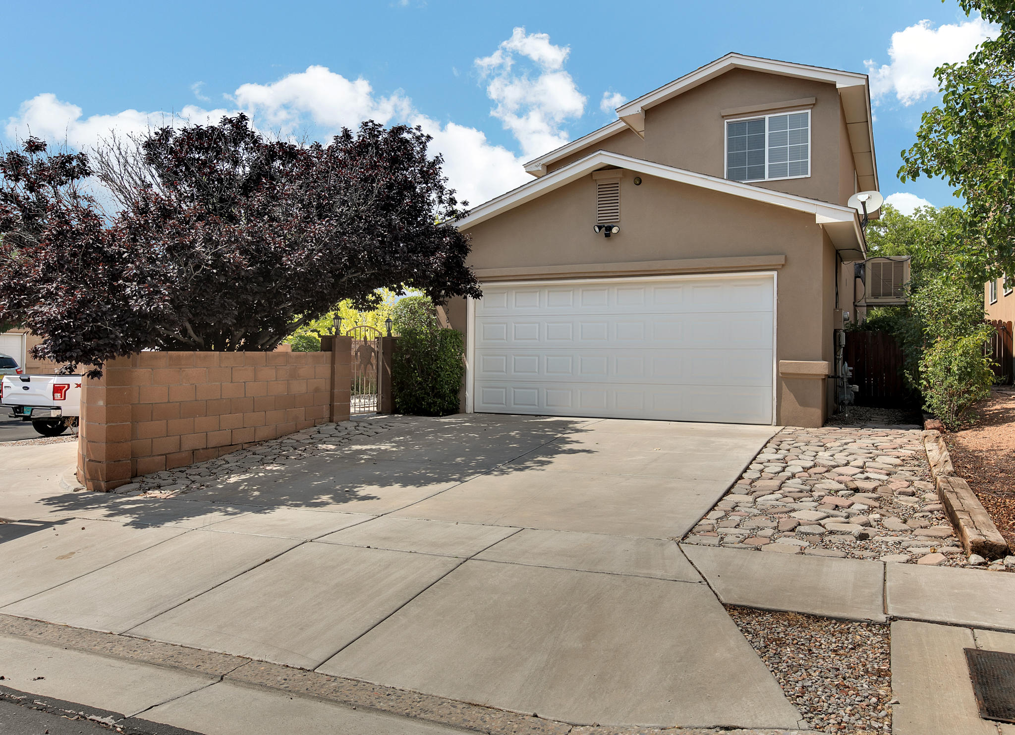 4 Bedrooms + Bonus Room in La Cueva School District.  Built by Joe Boyden, you are greeted by a large, open great room that extends to the dining space & kitchen.  1 bedroom on the main level + heated & cooled bonus space.  Corner lot as 2 accesses to the courtyard.  Master bedroom is located upstairs and has cathedral ceilings, walk-in closet & large master bathroom with jetted tub, separate shower & double sinks. The kitchen has a breakfast bar, double oven, plenty of counterspace & convenient access to the half bathroom. Located with easy access to Paseo, I-25, restaurants, grocery shopping & excellent schools.  Schedule your private showing with a Realtor today!