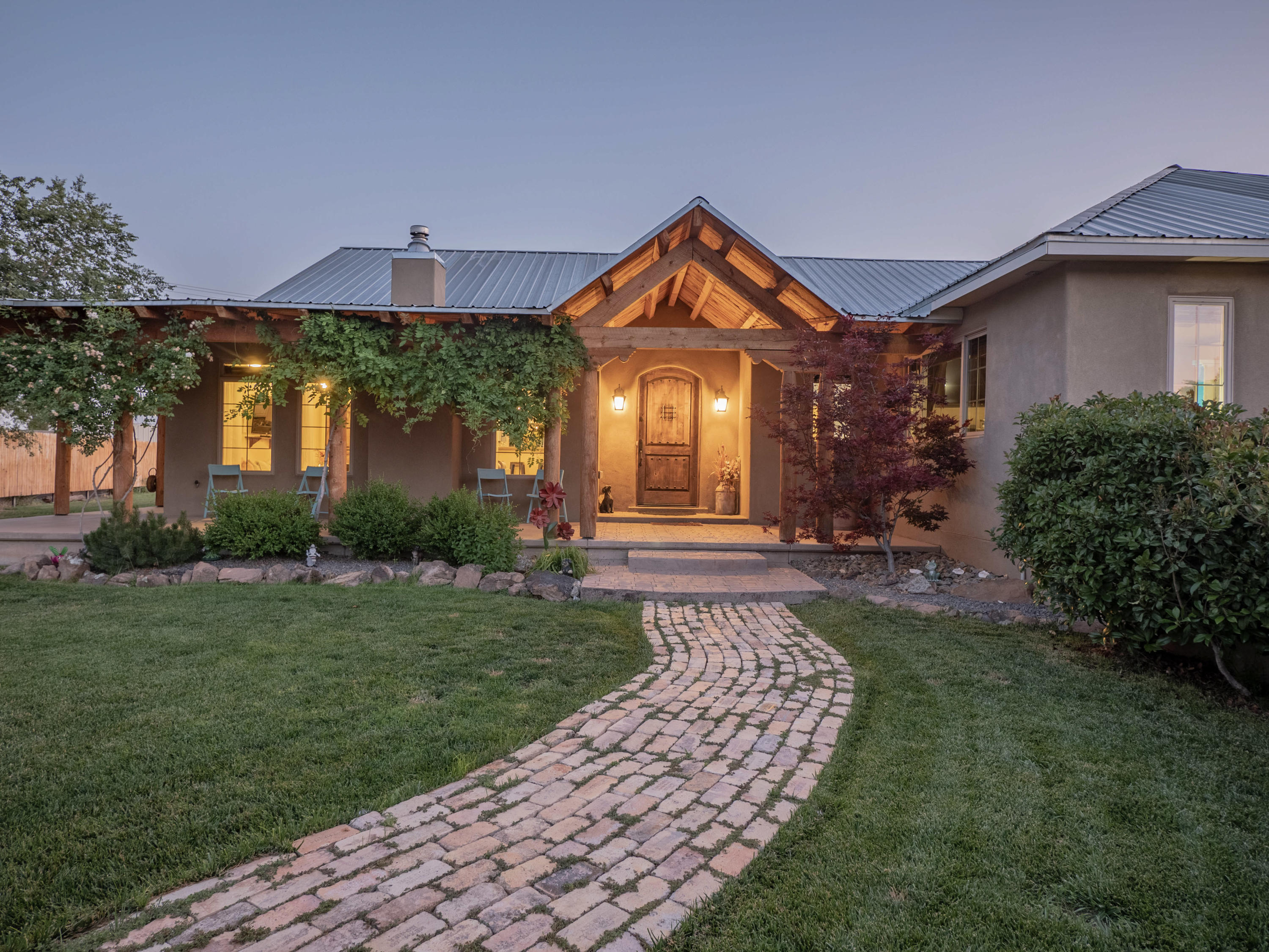 This stunning and meticulous North Valley custom-built home is a must see! The gorgeous fenced in courtyard leads up to a covered wrap around porch & sits above a well maintained lawn. The unique features of this newer built home are centered around an open floor plan that's polished with tons of natural light. The stylish kitchen offers a walk-in pantry & an additional sink anchored by a huge breakfast bar overlooking spacious countertops.The home provides 4 bedrooms & a separate office. An entertainers backyard showcases a large patio with additional shade & a side yard big enough for an RV & other toys! This home is centrally located in the city & near Open Space & bike trails.
