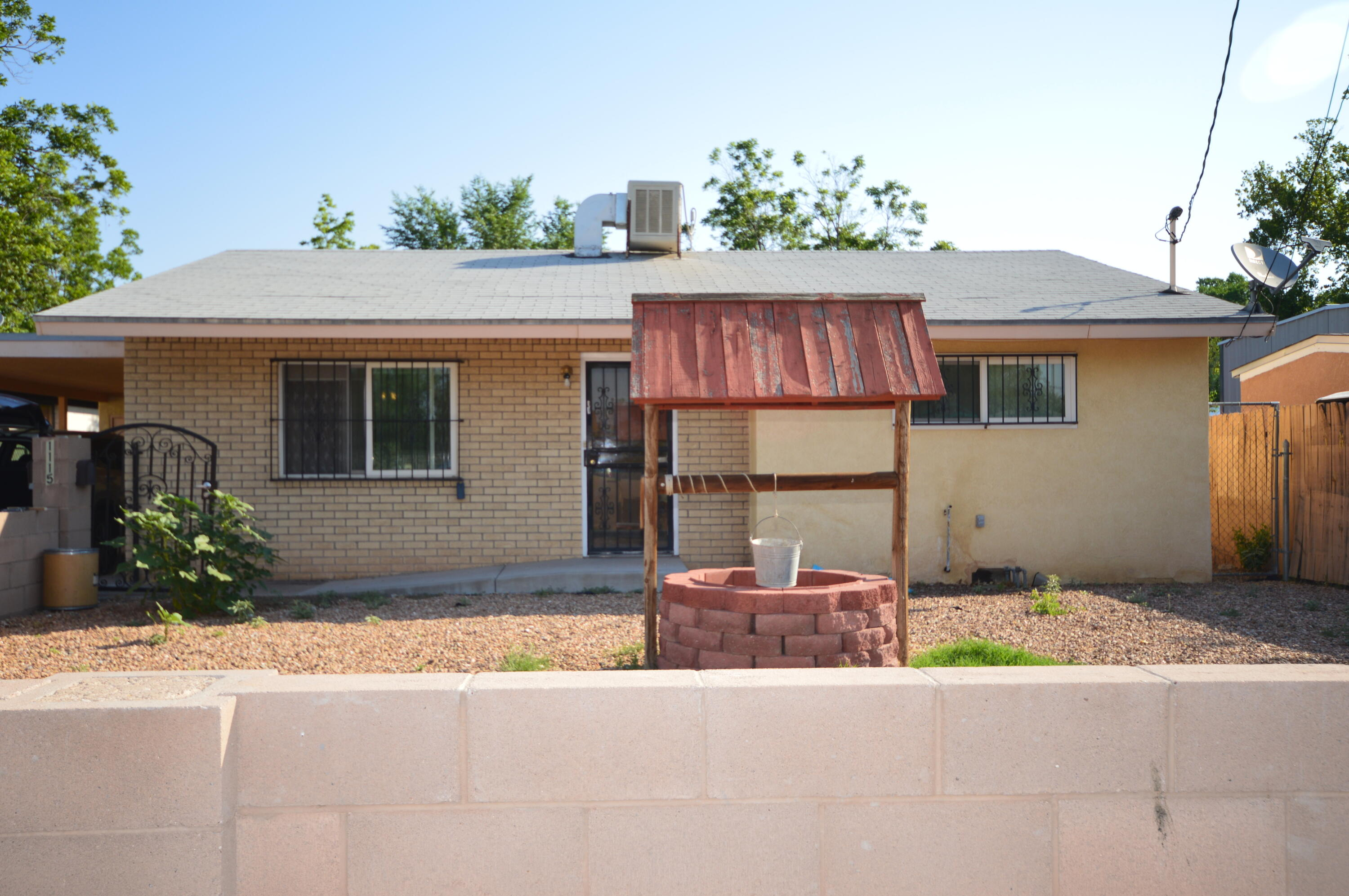 Located on a quiet street, this north valley home has a large living room, dining room and kitchen complete with gas stove, dishwasher and refrigerator. Two spacious bedrooms: master with large walkin closet and second bedroom with builtin desk. Living/dining room and bedrooms have laminate flooring. Covered carport and storage room. Backyard is highlighted by large covered patio and storage shed.