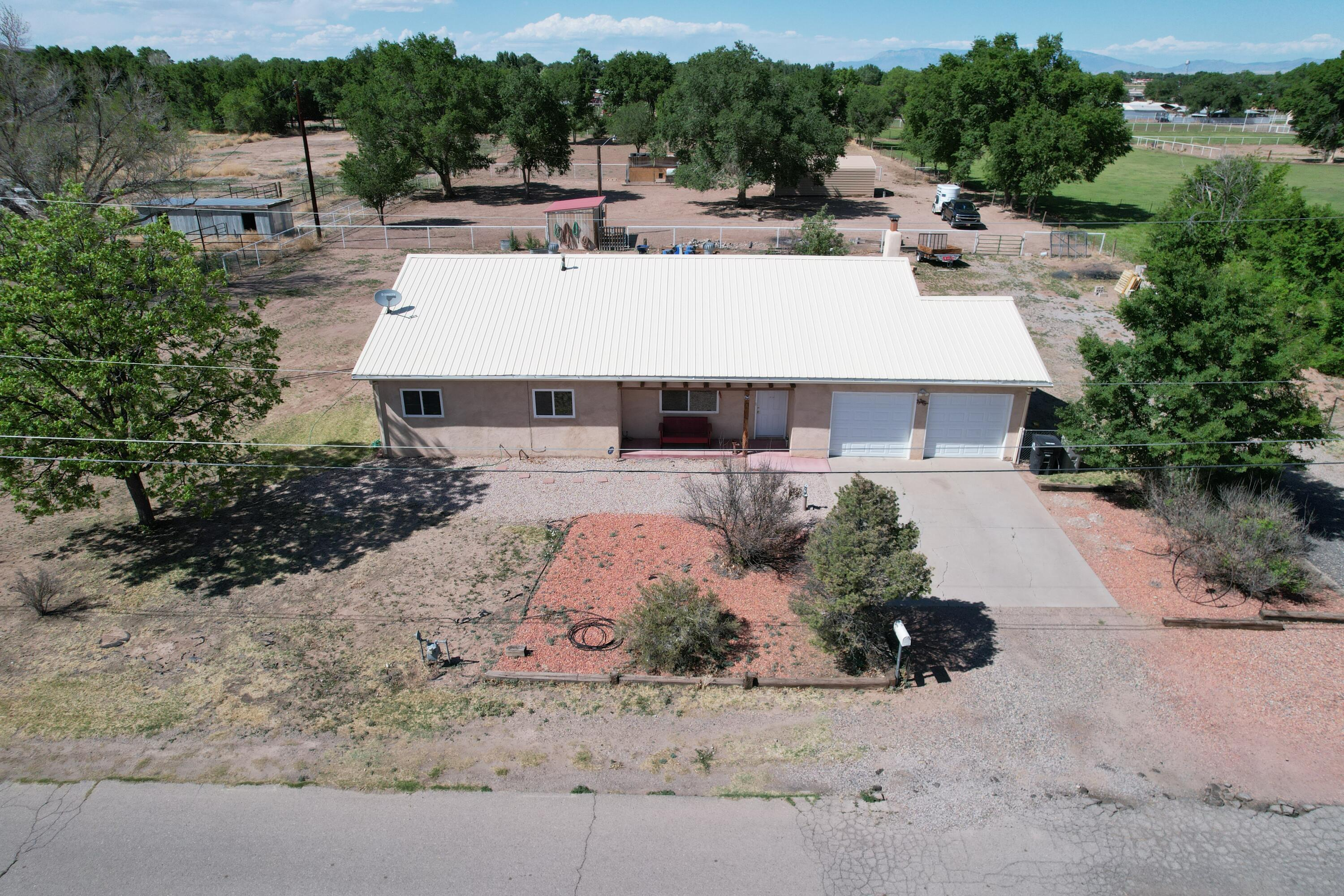 This 1800+ sq foot home with 3 bedrooms, 1.75 baths and an attached 2 car garage sits on 1.92 acres of country setting with fencing dividing property into 3 sections. Comes with a metal structure used as a horse barn, chicken coup which houses 16 currently and a storage. Plenty of room for the animals or family gatherings or both. The home features  refrigerated air to keep cool in the summer months as well as a fireplace in the living area to heat up during the winter months. The kitchen is open for easy entertaining. The master bedroom boasts an up dated bathroom with a huge walk-in closet. Pride of ownership really shows on this home.