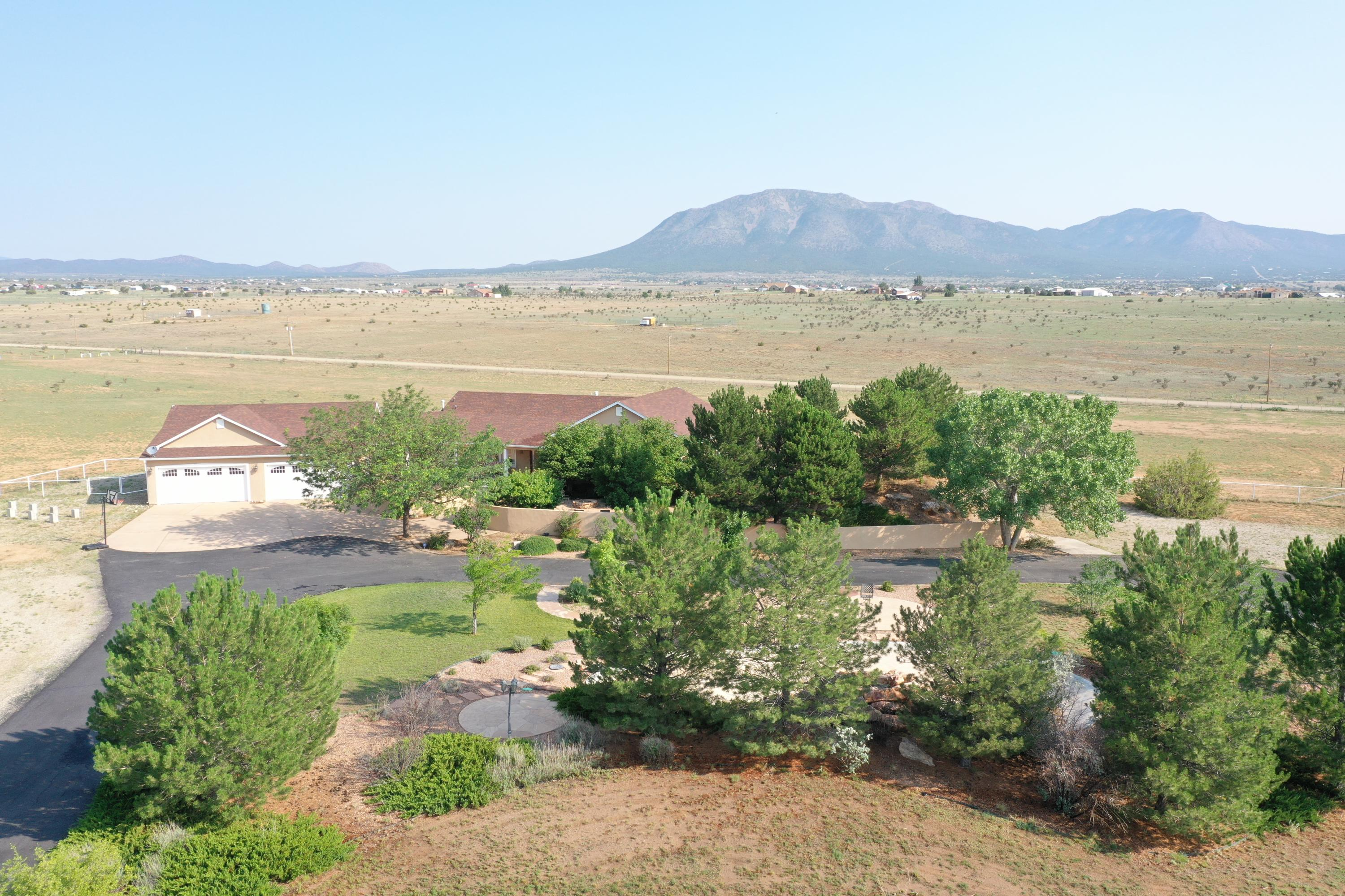 This is your rare chance to own the premier equestrian property in Edgewood, NM and southern Santa Fe County! A luxurious estate home 6130 sqft heated and a guest house of 989 sqft heated all on 38.5 acres. Main home boasts hardwood oak flooring, grand open great room with a formal dining area, breakfast nook, gourmet dream kitchen, and sweeping mountain views of the Sandias and South Mountain. The family room off the entry is perfect for relaxing activities away from the crowds. The garage leads you to a home gym, walk in pantry, and into the kitchen. Master Suite is large enough for a sitting area and two master bathroom suites: 3/4 bath in master and luxurious spa like full bath in the master suite. 30 mins drive to ABQ and 50 mins drive to Santa Fe! See additional info for more...