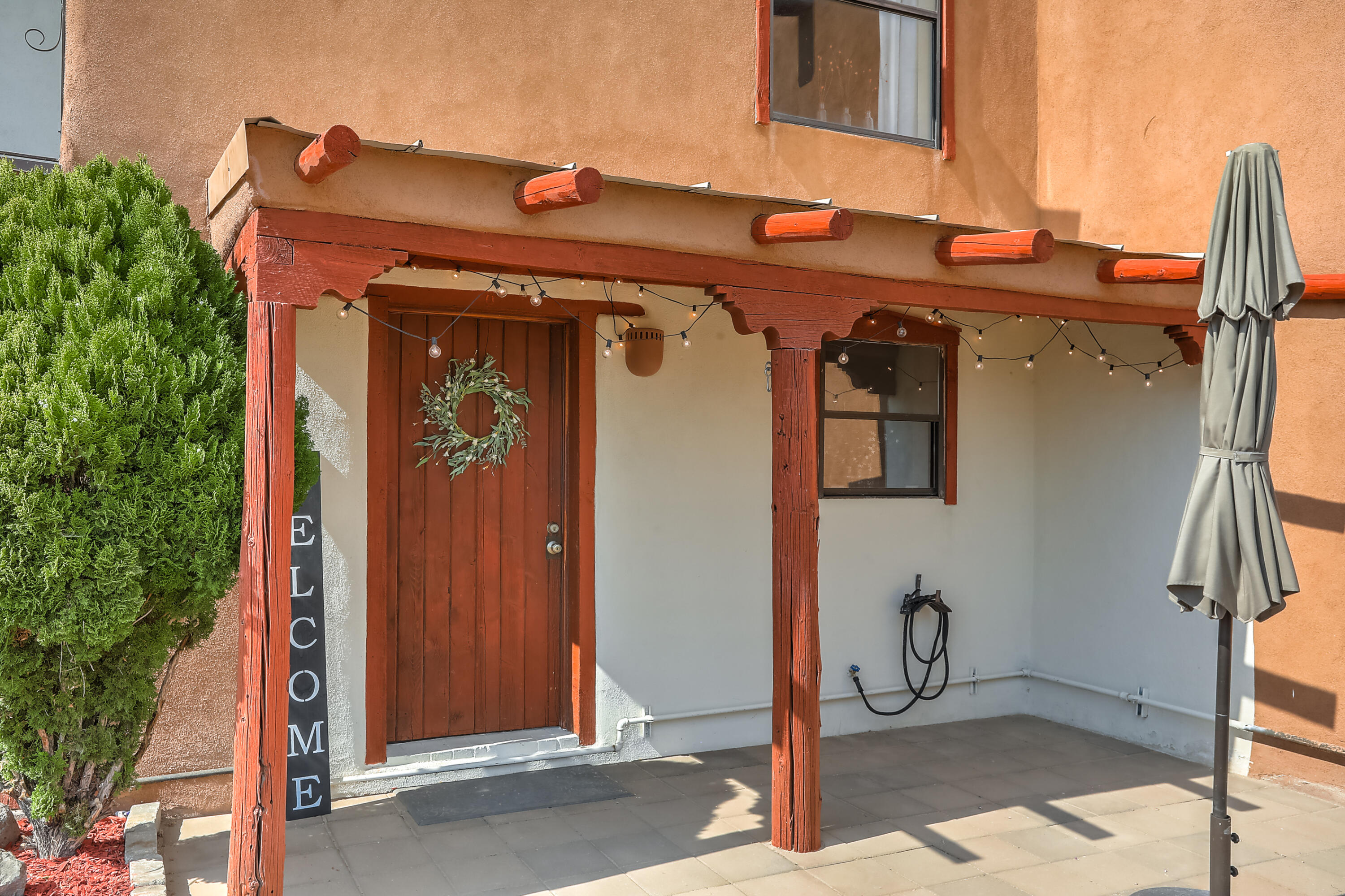 OPEN HOUSE 6.19.21 Saturday 2-4.  MARVELOUS 2-story townhome in Corrales with outstanding views! You will fall in love with the light and bright country interior with all the modern touches. Refinished brick flooring and a corner Kiva fireplace with banco seating and a wood ceiling--what's not to love about this southwestern gem?  Cute kitchen with plenty of cabinet and counter space for cooking up your favorite Southwestern dishes. 2 bedrooms upstairs with nice-sized closets and tile flooring. Private deck off of the master bedroom and a beautiful private backyard patio where you can sit and take in all that New Mexico fresh air. This is a great find, in a great place, at a great price! Schedule your showing today!