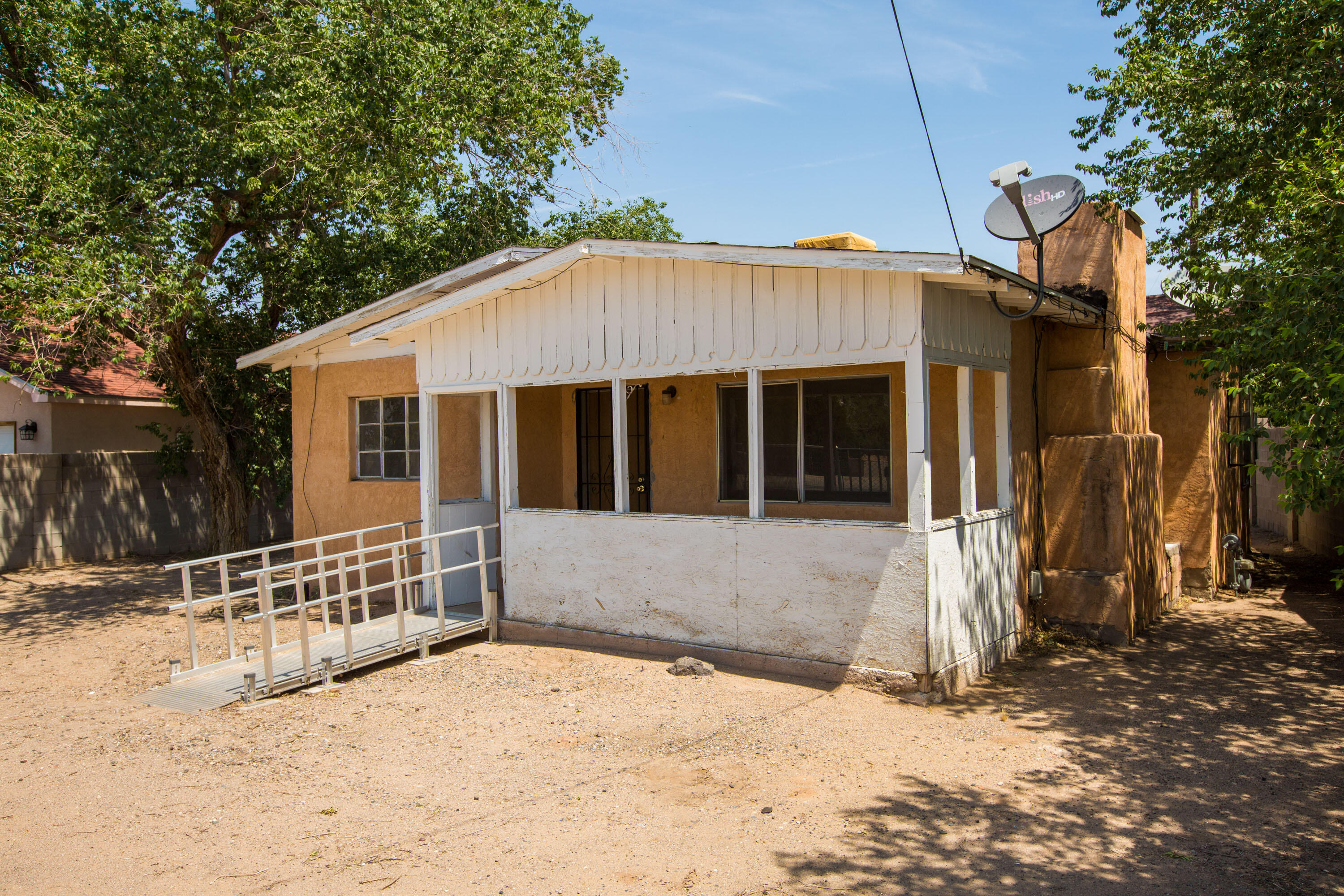 A must see 2 bedroom 1 bath home on .21 acres in the Carlos Rey Subdivision is an investor or handyman's special with loads of potential, backyard access and an a well. Close to many amenities, downtown, Zoo, Bio Park and 20-25 minutes from KAFB/UNM.  This will be an ''As is Sale''.