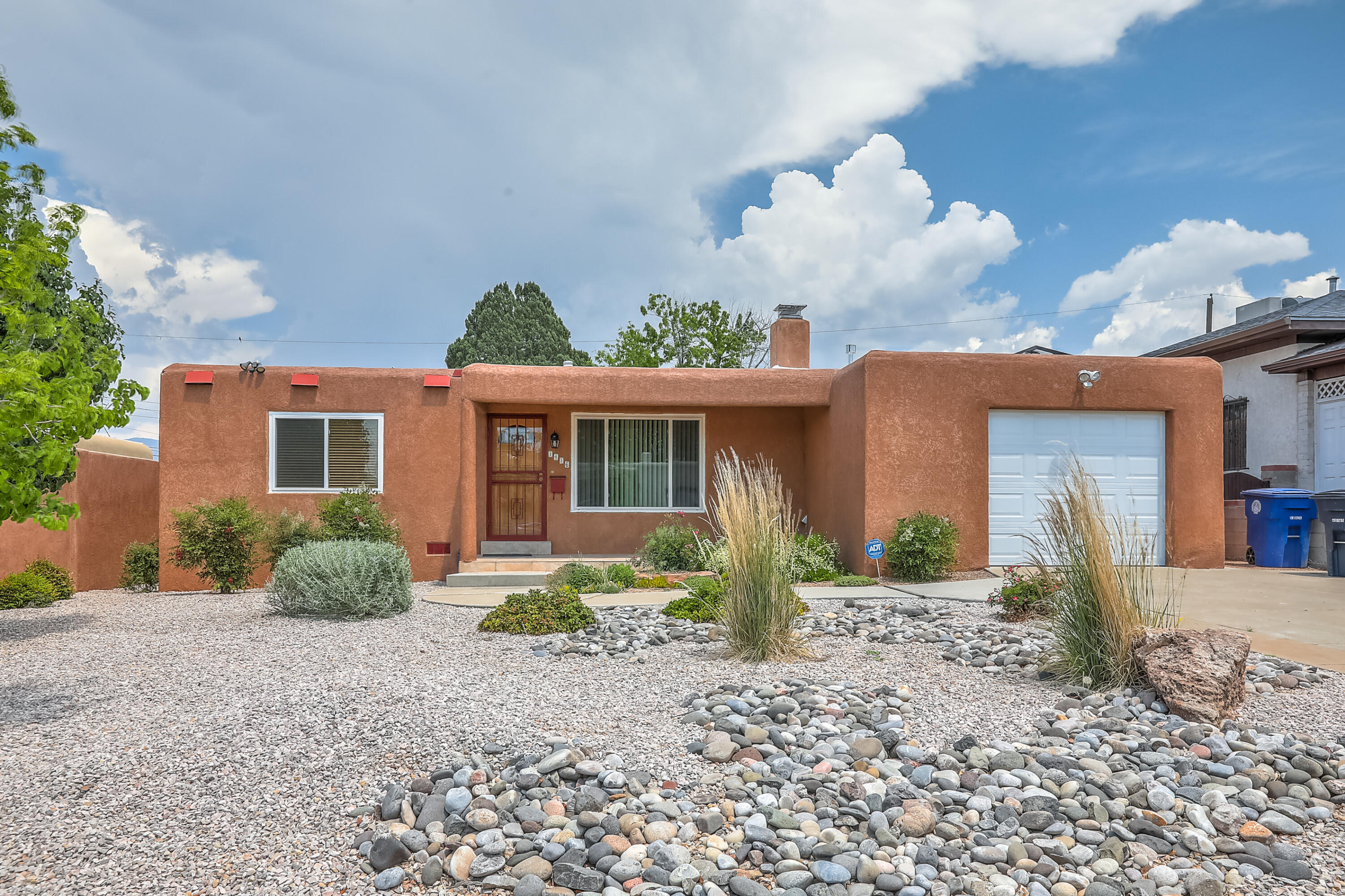You won't want to miss this open house on Saturday June 19th from 10am to 12! This 3 bed, 2 bath, North UNM gem is move in ready and complete with a brand new roof with warranty. It's beautiful front and back yard landscaping compliments the east facing back yard. Inside,  hardwood floors are found throughout the home other than the beautifully tiled bathrooms.  The large living room is highlighted by a brick fireplace and a large west facing window to a view of your beautifully landscaped front yard and cozy porch.  Or you can cool off this summer with central forced air supplied by the owned solar unit on the roof!