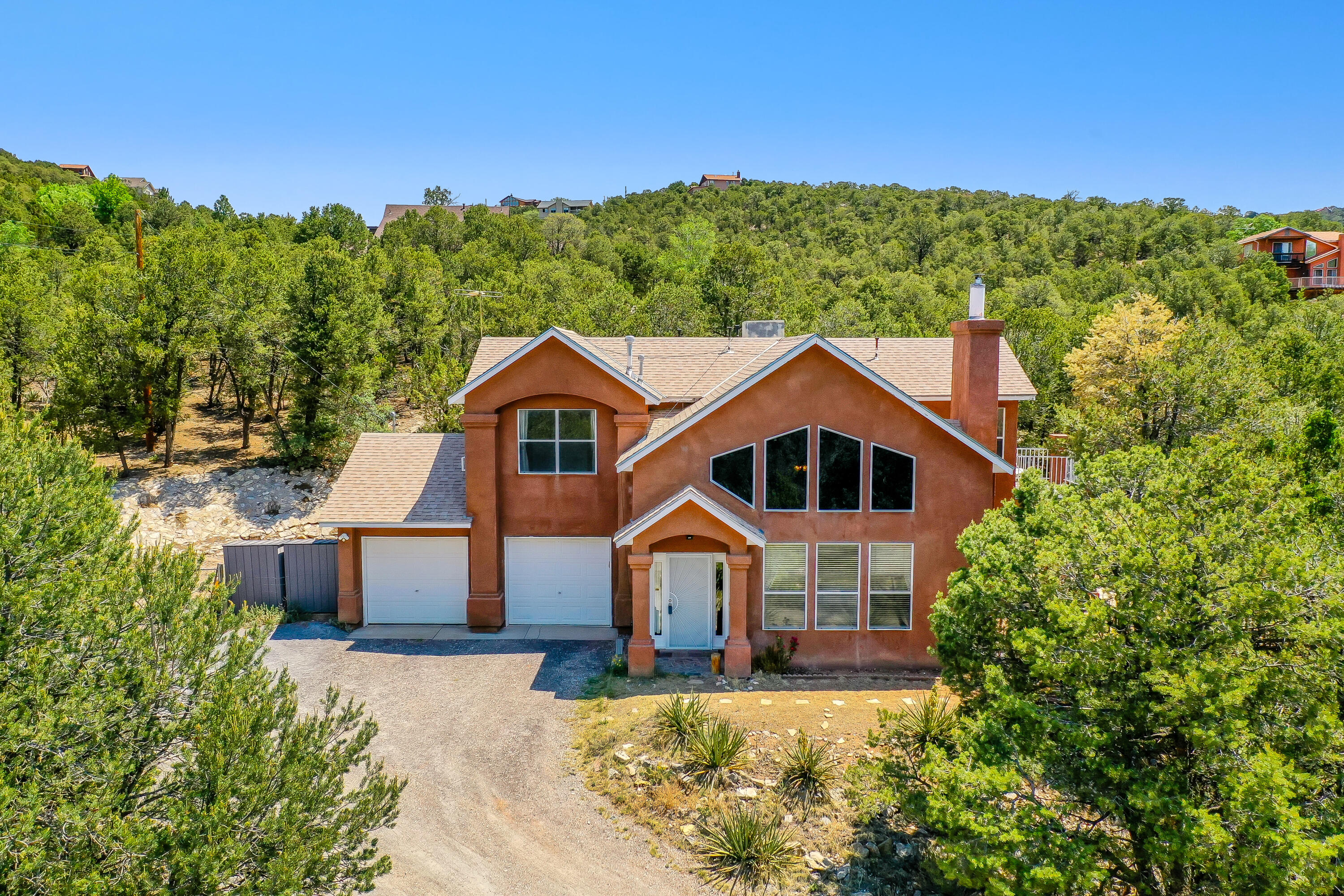 Mountain living just moments from Albuquerque! This move-in ready home has views that will take your breath away out every window! Enjoy the natural lighting in the great room that acts as solar heating in the winter, and the semi-tinted & UV-protected windows allows for cooler living in the heat of summer. Sitting on about 1 acre, you'll have your very own mountain retreat with a large deck and gravel patio to entertain or relax. New water heater installed in 2019. A water softener as well as a reverse osmosis water filter are already installed to enjoy your fresh, crisp well water. A shared well, non-leased 500gal propane tank, and your own septic tank & drain field allows for low-cost maintenance year-round.