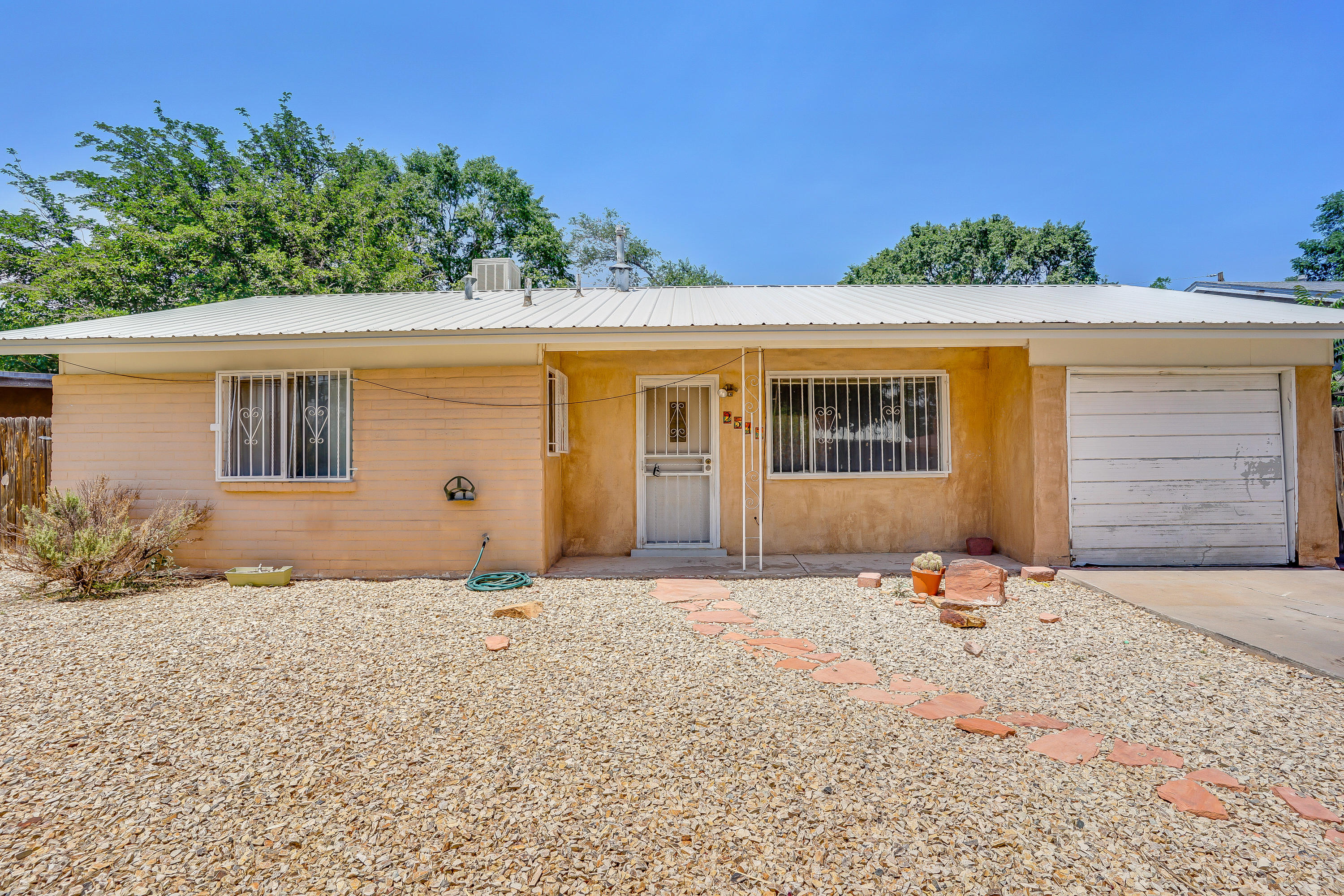 Welcome to this great home in the Valley Gardens neighborhood.  This home features a nice open kitchen & living area as well as 2 nice size bedrooms.  Recent updates in 2020 include new metal roof, furnace and cooler.  Large backyard with mature trees and a nice storage shed too.  Come see this great property today.