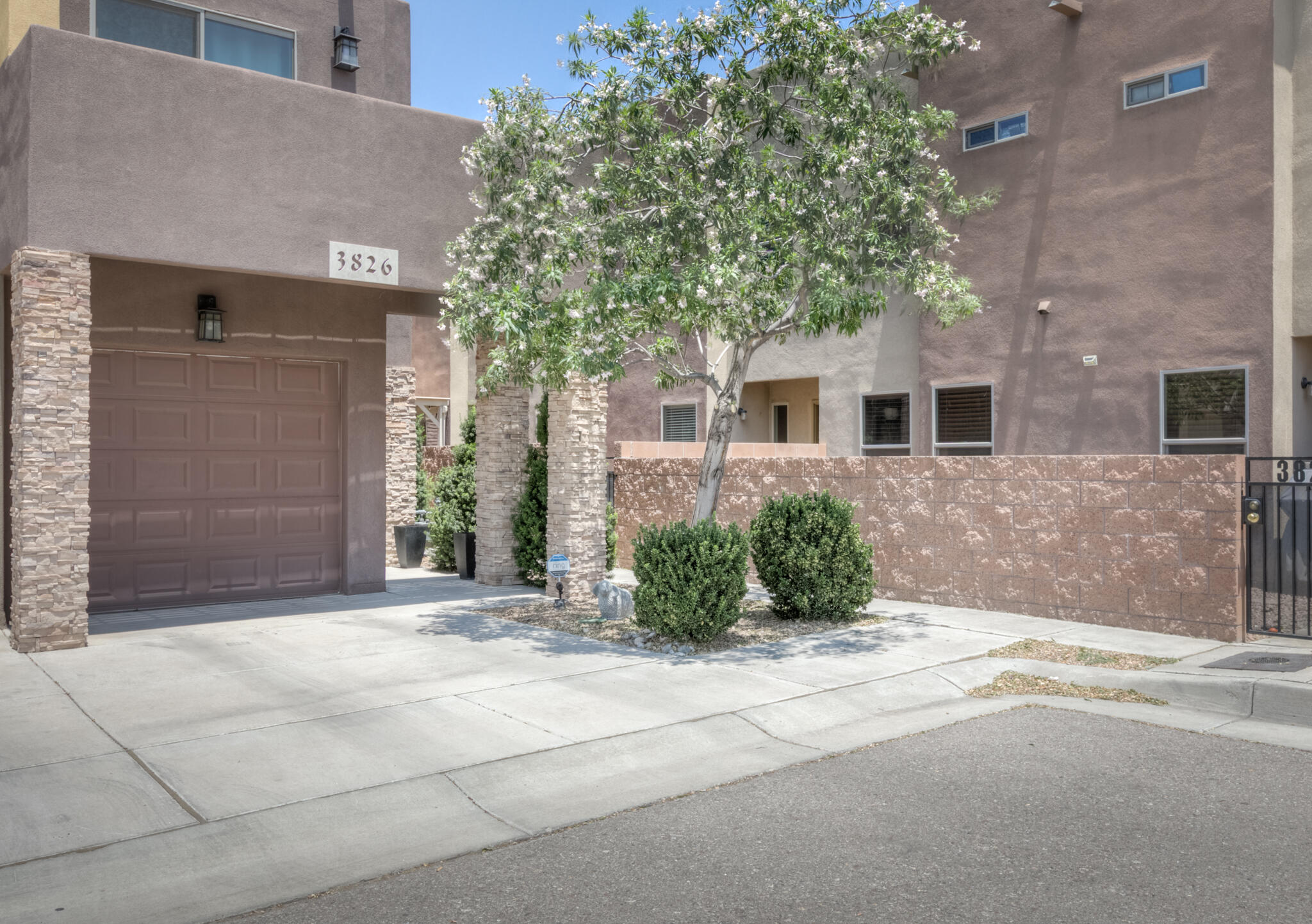 NICE!  Ideal for first time buyer, college students (kiddie condo), professionals and investors.  Centrally located near UNM, hospitals, downtown, malls & major freeways.   Energy Efficient Townhome with Refrigerated Air and Low Maintenance Yard.  Open Floor Plan, laminate and tile floors, Arched Doorways.  Stainless Appliances.  Great space for Gatherings or Peaceful Solitude. Spacious Master with His/Her Closets & Mountain View.  Bedrooms and Laundry Upstairs for Convenience. Air Gap & Sound Deadening Board between dwellings, Blown-in Insulation & Low E Glass Lower Utility Bills.