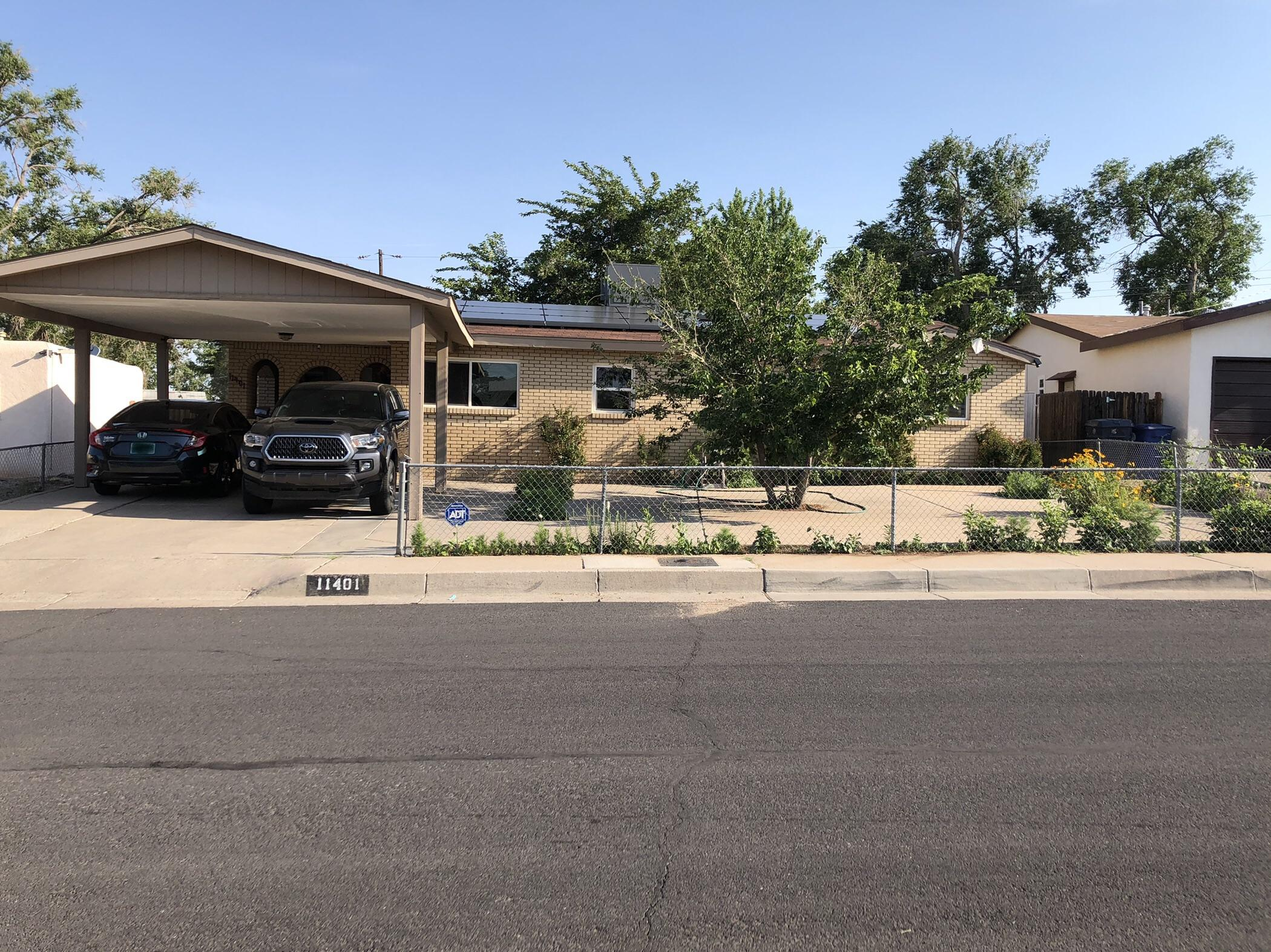 Welcome to a charming 1850-square-foot, 4-bedroom, 2-bath home in the NE Heights! The kitchen has plenty of beautiful granite counter space, and hardwood, tile, and laminate flooring throughout make cleaning a breeze. The huge master suite has a bathroom with dual sinks, a walk-in closet, and private backyard access. Refrigerated air will keep you cool on hot summer days, and the solar system (leased) will provide year-round energy savings. The backyard offers the best of both worlds, with a refreshing in-ground pool and large yard for gardening or pets. The roof is newer, and the water heater and pool pump are brand new. Other amenities include a separate laundry room, security system, Ethernet, covered patio, two-vehicle carport, a pool shed, and a huge storage shed/workshop with power.