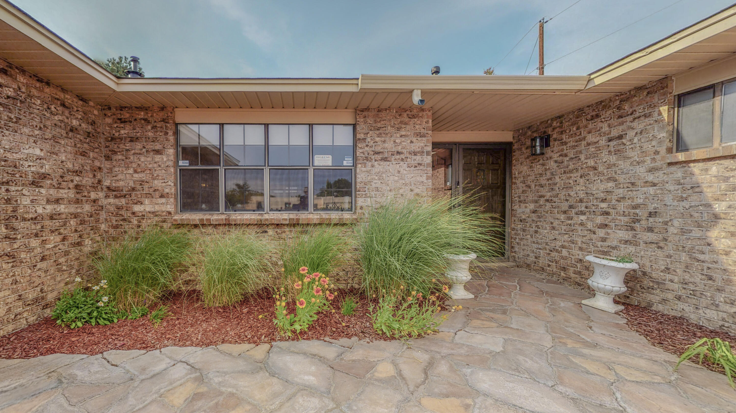 Feels Like Home! Outstanding, hard to find 1-Story, Brick Home is nearly 2,500 SF, on a 1/4 Acre Homesite. Nestled in the Foothills,  this ''Must See'' has 4 Bedrooms, 3 Baths, 2-Car Gar.,   Refrigerated A/C, Updated Kitchen & Baths., Granite Countertops, & lots of Hard Surface Flooring. Island-Kitchen has newer Cabinets & High-end Stainless Appliances- inc. the Frig.  Kitchen is Light & Bright & is Wide-Open to the Family Room, making large family gatherings a pleasure. Front of Home features a Gated Courtyard, Lovely Landscaping & Roses, & a Side-yard big enough to park an RV. Backyard has large Covered & Open Patios & Easy-care SW Landscaping. A Large Storage Shed is also inc. This Impressive Home has been Very Well Maintained, & You Won't be Disappointed!