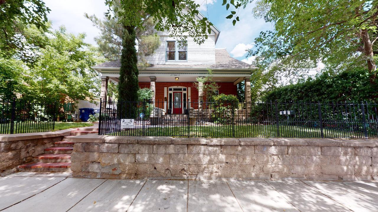 One of the most rare & stately historic estates in ABQ with 3 darling 50's era apts tucked in backyard & generating significant income. 2 CA Garage & basement too! Amazing artifacts found in hidden eaves/crawlspaces on display for showings (featured on HGTV). Traditional feel on main level w/ stately stairwell, formal LR, huge DR w/ built in hutch, enormous kitchen, 2 BR, bathrm w/ claw footed tub & secret fort under the stairs! Upstairs an expansive loft, vaulted 2 stories to the roof line, bright w/ ample windows & skylights. Lg master suite with 3/4 bathroom, billiards room, multiple living areas, office & sm rm tucked into eaves, wood burning stove, incredible bar with antique stove and fridge, full bathrm. Two 3rd story lofts, one w/ sliding ladder, one w/ spiral staircase &