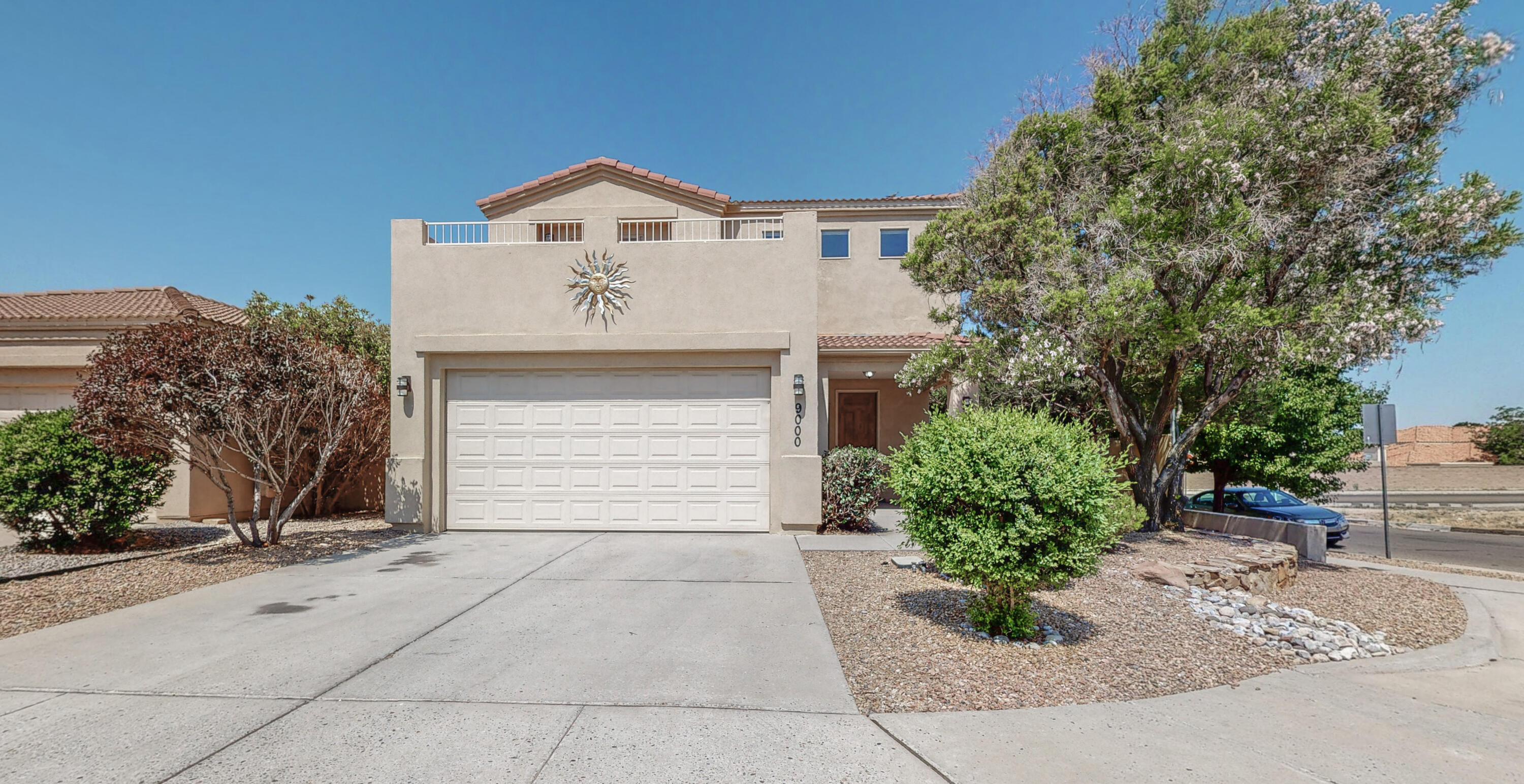 Great Views!! Warm and inviting move-in ready home in the high demand ABQ Acres West area. La Cueva High School District and convenient location near shopping and dining. Enjoy views of the Sandia Mountains and nighttime city lights from 2 spacious second-story patios! Bright living room has gas log fireplace and ceiling fan. Brand new freestanding gas range and dishwasher, beautiful & easy-to-maintain Corian countertops, and an office with French doors adjacent to the dining room. Wood and tile floor throughout, refrigerated air, waterfall feature & covered patio in the backyard and artificial grass. The spacious Master Bedroom has separate garden tub and shower as well as a sunny patio! This is the house for you!