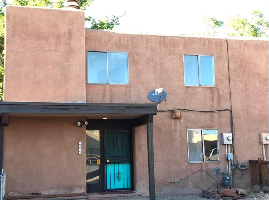 Come see this cozy home that is located in the Atrisco Neighborhood. This townhome comes with 4 bedrooms and 2 bathrooms and southswestern style fireplace located to the left in the living area as you come in. This area has so much to offer as you are just right up the road from the Bosque, Zoo and and great things to explore alonf the riverside bluffs. This comes a complete roof replacement in 2020 and a new A/C unit replaced in Febuary 2021.