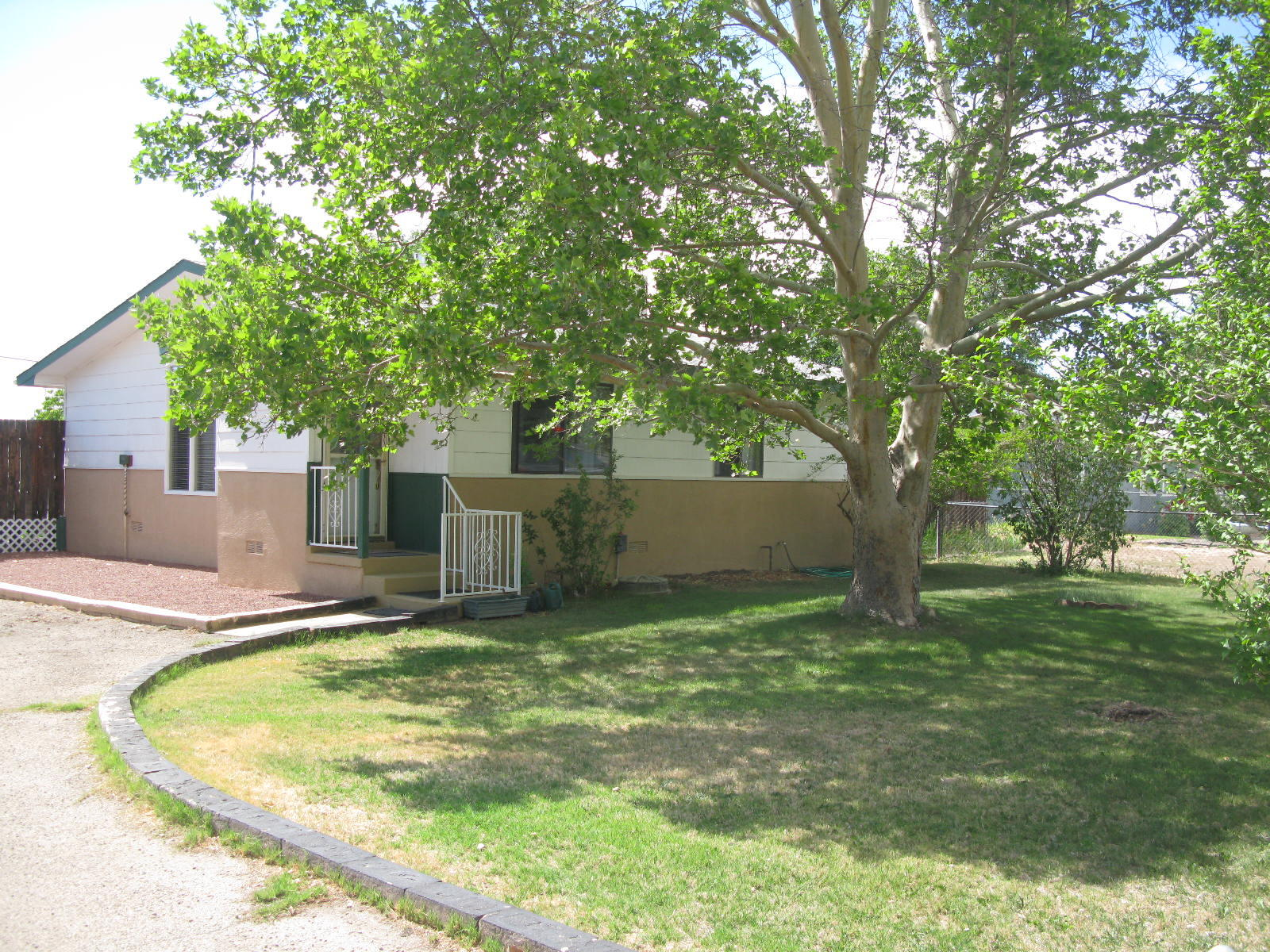Adorable Bosque Farms Cottage! Beautifully maintained home on spacious one-half acre in Bosque Farms. Kitchen updates include new backsplash, sink, faucet, and gorgeous English red-oak flooring. Large master bedroom with an updated master bath. Relax on the back deck or two additional open patios and enjoy the greenery. Three storage buildings. Detached two-car garage. Very nice set-up!