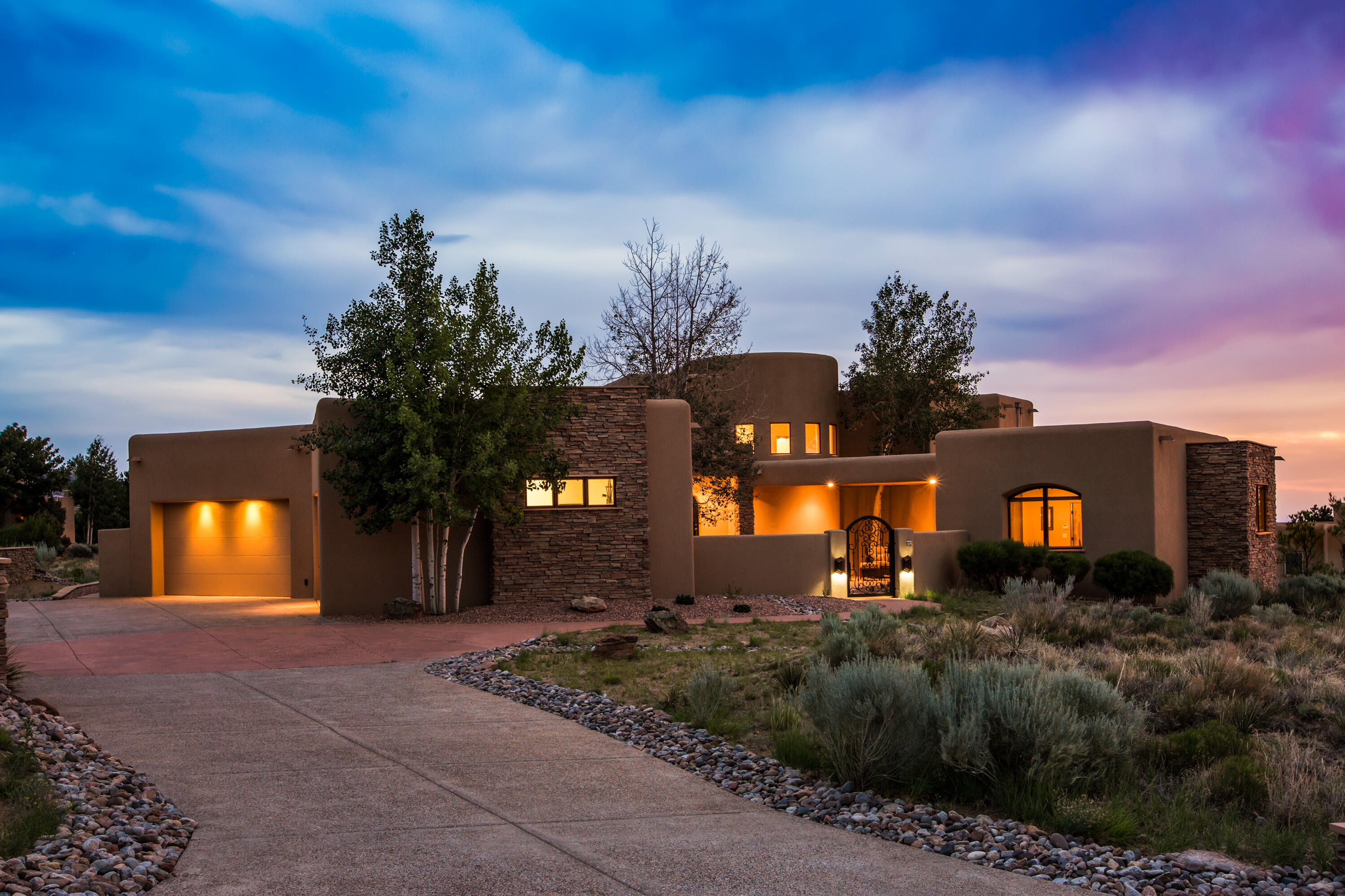Incredible find in High Desert, Albuquerque's premier master planned community located in the foothills of the Sandia Mountains.  This home has beautiful views in every direction including the mountains, and city lights. Designed for gracious living, this home offers both casual and formal living and dining spaces, a beautiful kitchen with handcrafted cabinetry and Wolf/ Subzero appliances, a gym, theater room, a wine tasting room, detached fully appointed Casita w/ kitchenette, and a beautiful courtyard with a sparkling heated pool with a ramada. High end finishes include elegant tile flooring, 2 wood burning fireplaces with stone surrounds, alder cabinetry, solid wood doors, and beautifully positioned wood windows. Hard to find 4 car garage with additional storage features an epoxy floor