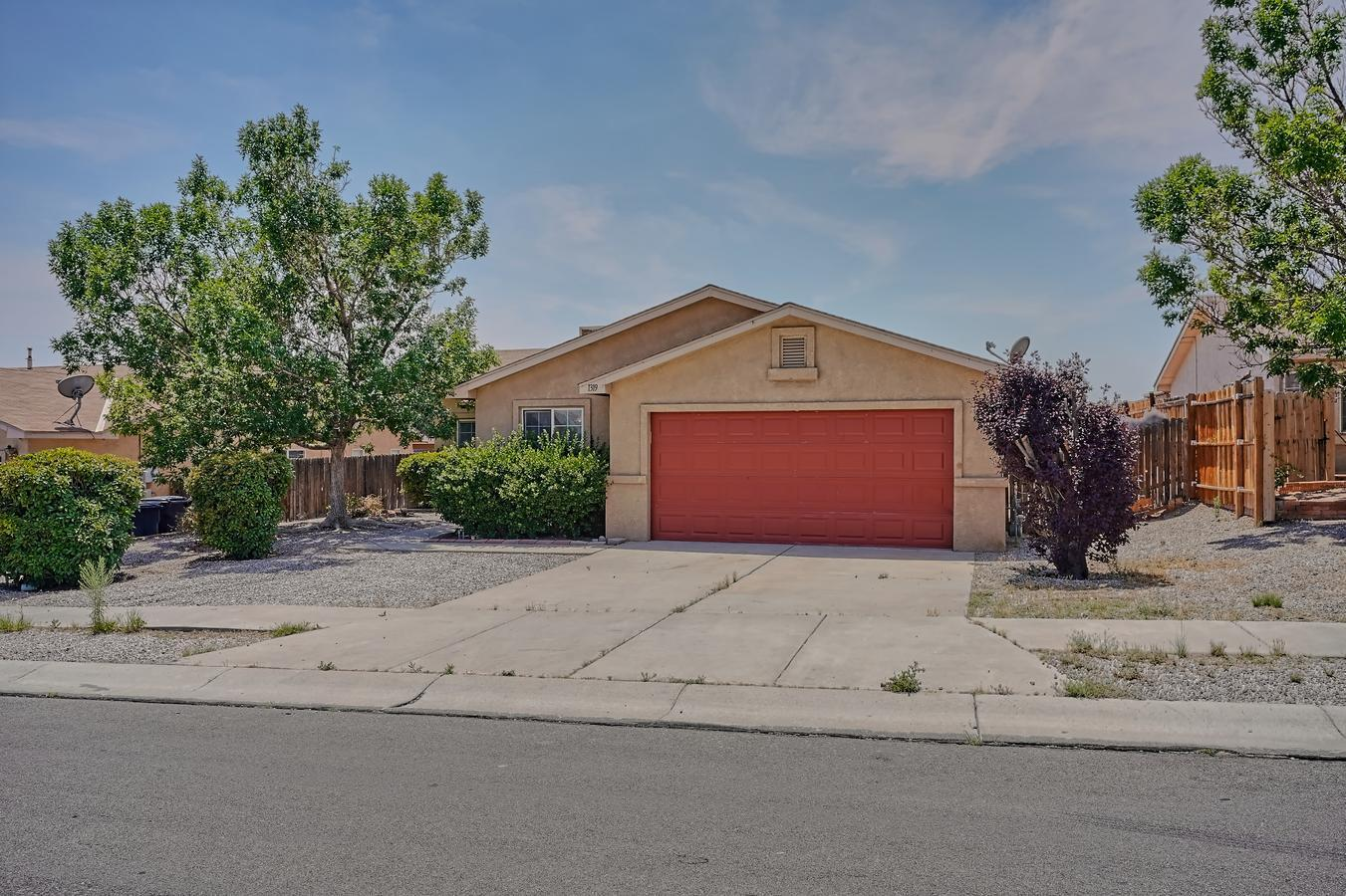 Three bedroom, two bath home just updated with new luxury vinyl flooring throughout, and new paint ready for a new owner. The home features a kitchen with adjacent dining area, large family room with high ceilings and a two car garage.  Quick access to Interstate 40 via Unser Boulevard.