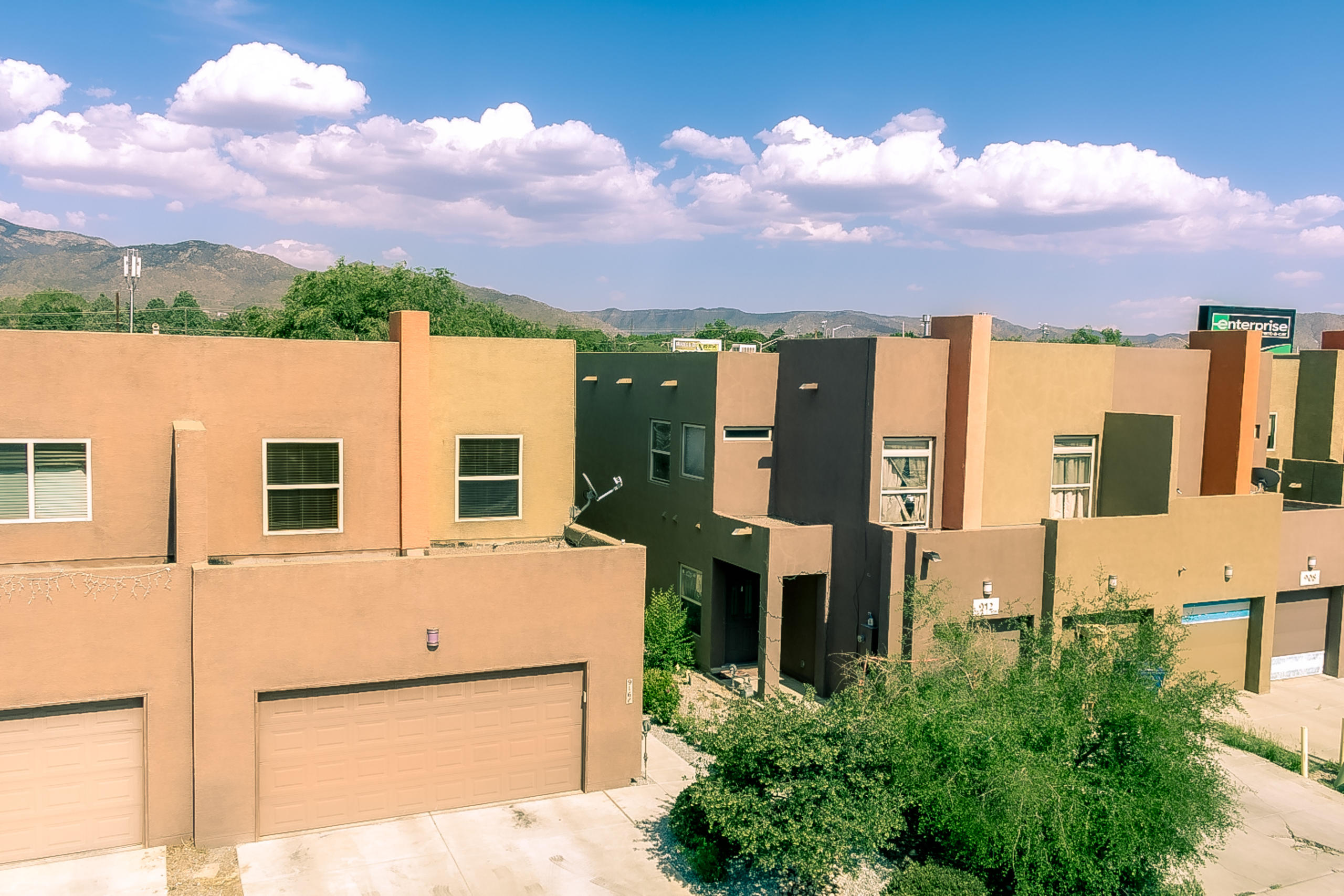 Former Parade of Homes winner! This semi custom Townhouse is centrally located near Uptown Albuquerque.  Mountain Views. Tons of natural light.  High Efficient heating & refrigerated AC, tankless water heater.  3 bedrooms + office/study. 2 full bathrooms & 1 half bathroom. Open floorplan. 18' ceilings in the living area. New paint & Carpet. All tile floors downstairs except carpet in office. Custom Kiva fireplace w/ stone accents.  Kitchen features knotty alder raised panel cabinets w/crown molding, custom tile backsplash, stainless steel appliances, spacious pantry & breakfast bar. Large owners suite features mountain views, walk-in closet, dbl sinks, garden tub & separate shower w/ oil rub bronze fixtures & trim.  Custom wrought iron & wood stair railings. Covered east facing rear Patio.