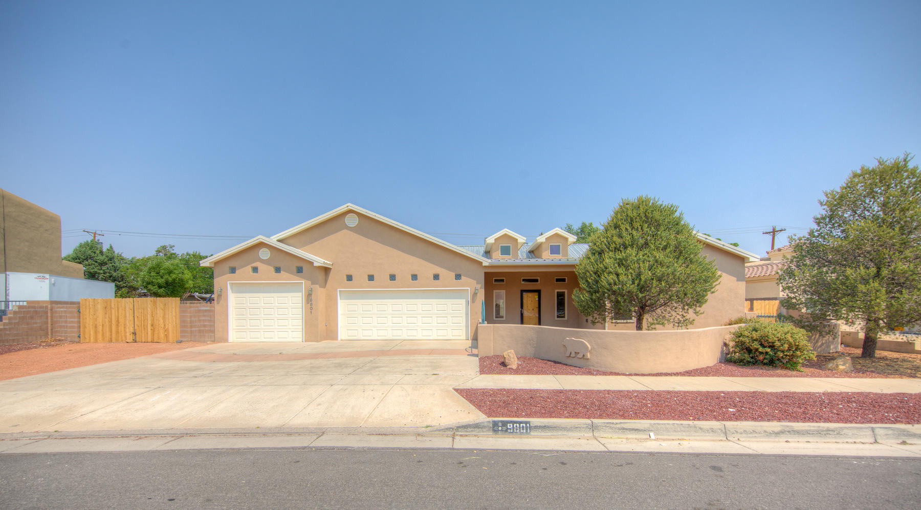 Spacious six bedroom home. Kitchen is complete with large island and stainless steel appliances. Ceilings are raised, spacious living areas and custom fireplace.