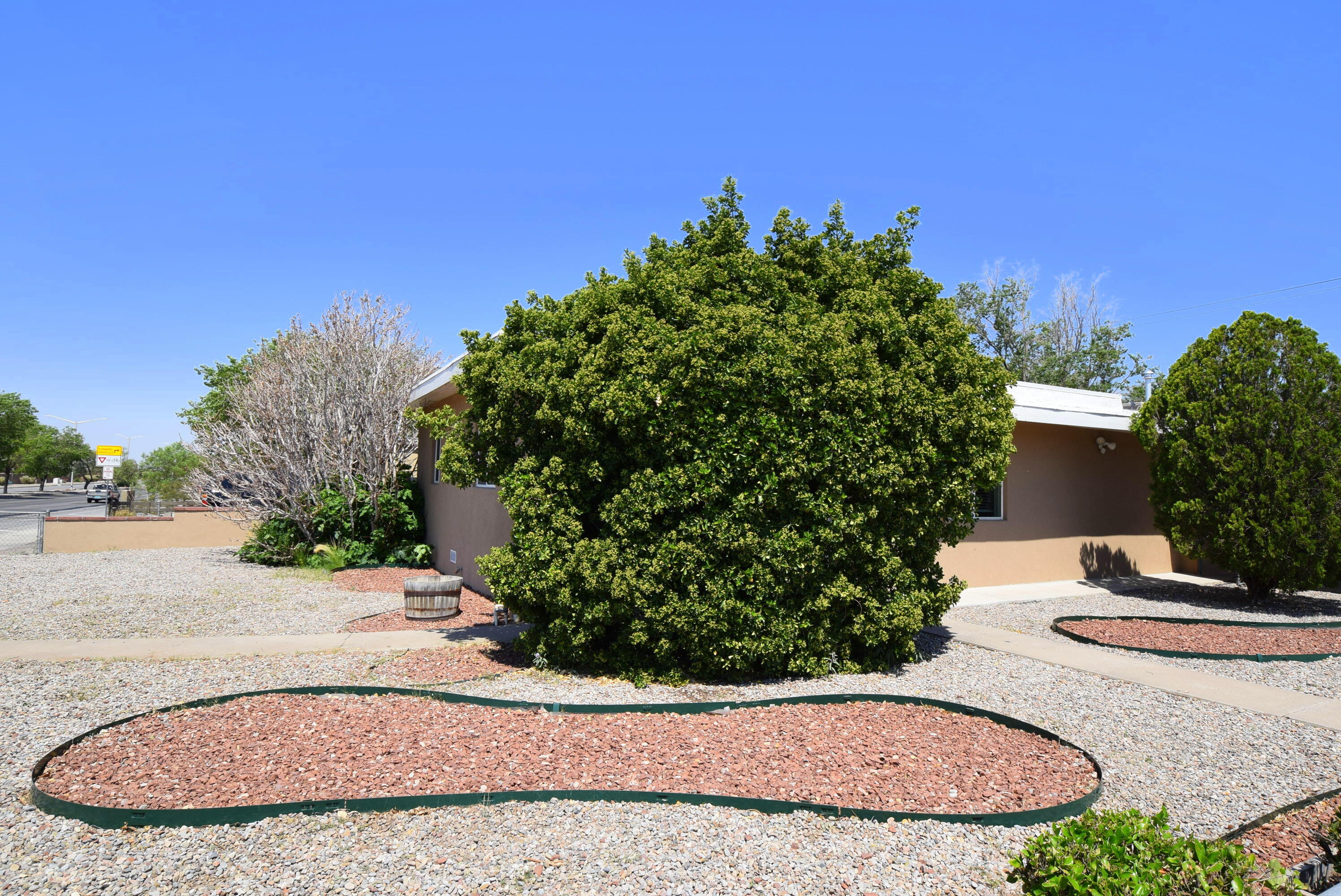Don't miss out on this one. Exceptionally clean remodel with so MANY possibilities. A HUGE yard ready for an additional income property or garage. The Front house is a 3 bedroom, 1 full bath that boasts granite countertops, stainless steel appliances, wood and tile flooring, breakfast bar, with Refrigerated air and it's own yard space. The back house is a cozy one bedroom, walk-in tile shower, with an open floor plan and opens to the huge yard. The main entrance is off Quency and has covered parking and storage. Great for Multigenerational living or an owner occupant income property. All electrical, plumbing, windows, water heater, furnace, counters, flooring and much more were upgraded in 2016. Conveniently located near base, VA and many more amenities. Enjoy the fruit trees!