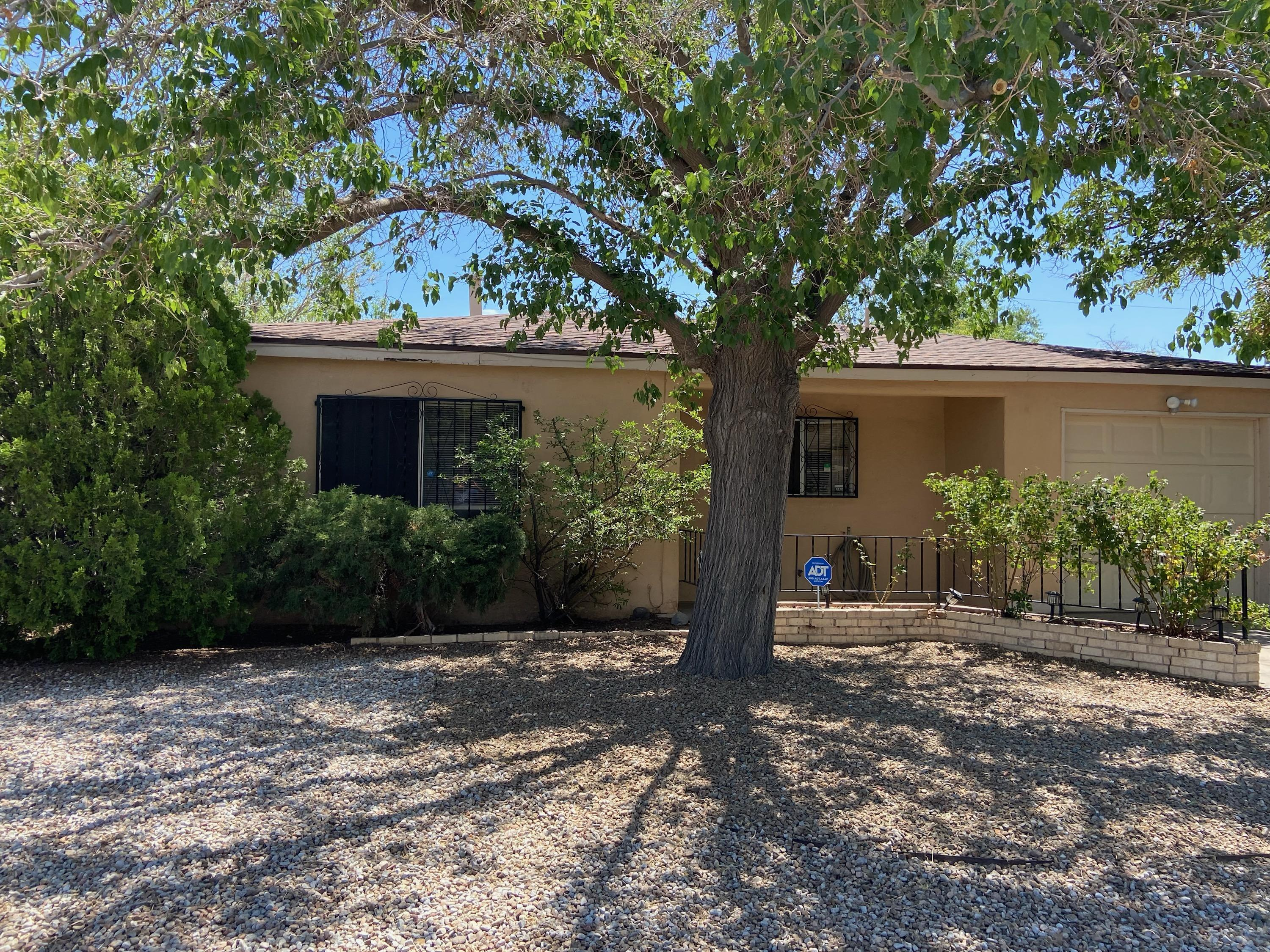 This property has a large yard with much potential. Country kitchen. Master bedroom has a sliding door to go out to the back patio.