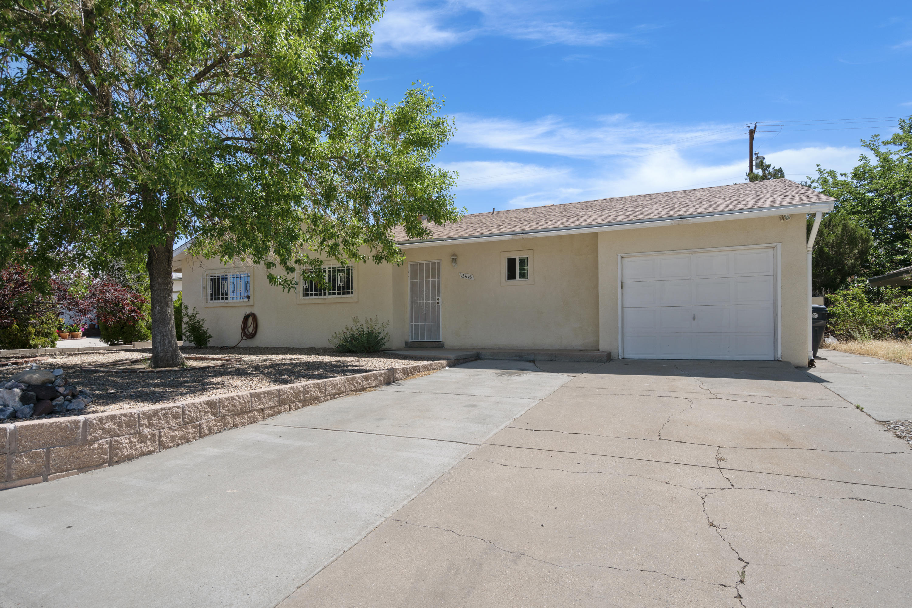 Walk in and enjoy the open concept floorplan with a completely updated kitchen! This single story NE heights home offers 3 bedrooms, 1.75 baths and a 1 car garage. Step outside to a large covered patio and green lawn, perfect for all of your entertaining needs! Recent updates include: roof and master cool 2018, stucco and windows 2014, granite counter tops, new cabinets, tile, French door, water heater and landscaped backyard! This house will not last long!