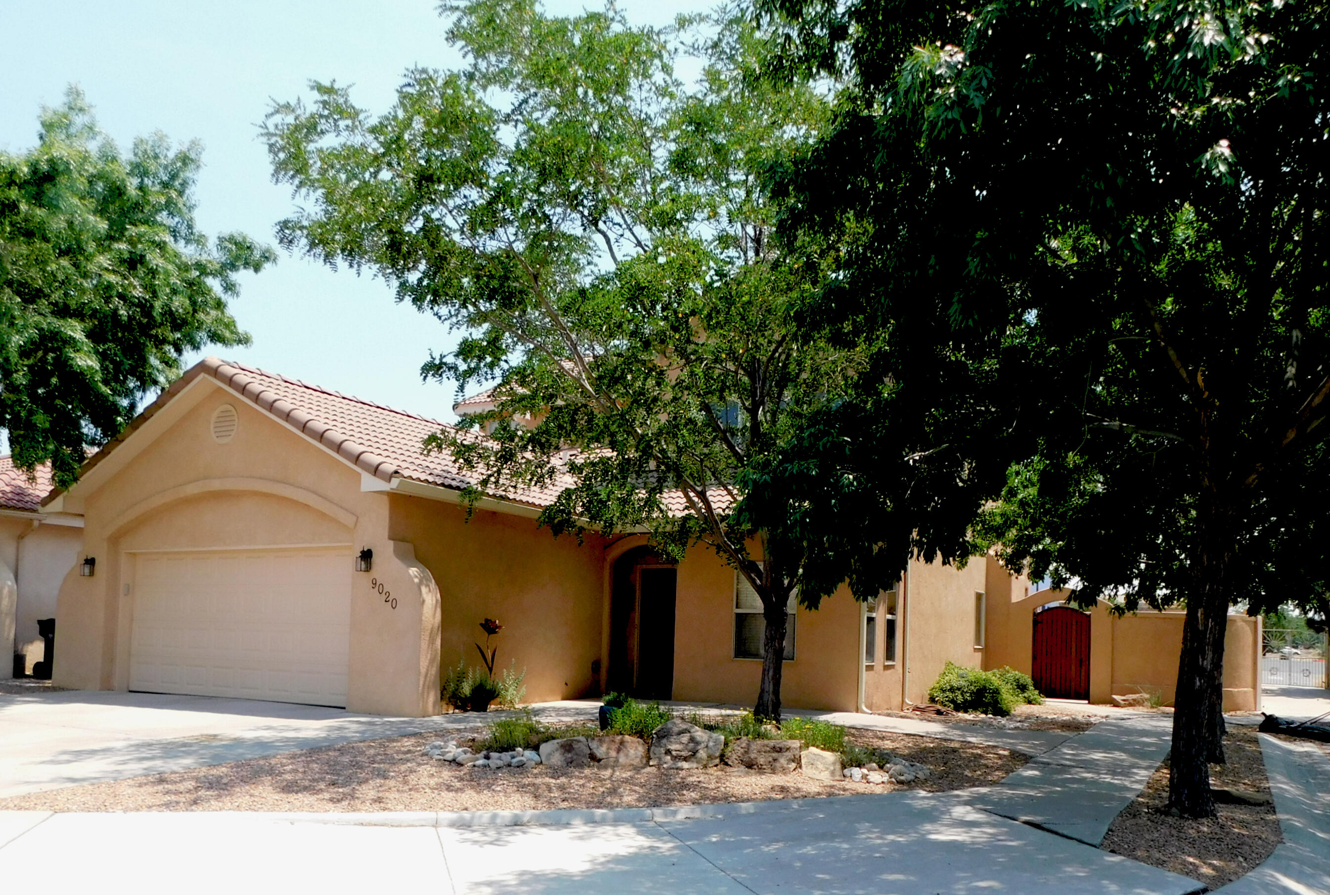 Located in the La Cueva school district on a private corner lot with no neighbor behind. The efficient country kitchen has a breakfast nook, stainless steel appliances, an Island, pantry and a bar for easy service to the adjacent formal dining room. Main bedroom with private ensuite is located on the lower floor. The private backyard paradise boasts a fan cooled covered patio and a 20 X 8 foot balcony, both overlook two waterfalls with a bridge to lead you over a running stream to the private hot tub. A 13 foot long griller's dream has a built in charcoal grill and a natural gas stainless steel rotisserie grill and burner with plenty of counter space on either side for a buffet or whatever! The finished garage has a 220 outlet and pull down steps to the storage attic. Shopping close by!
