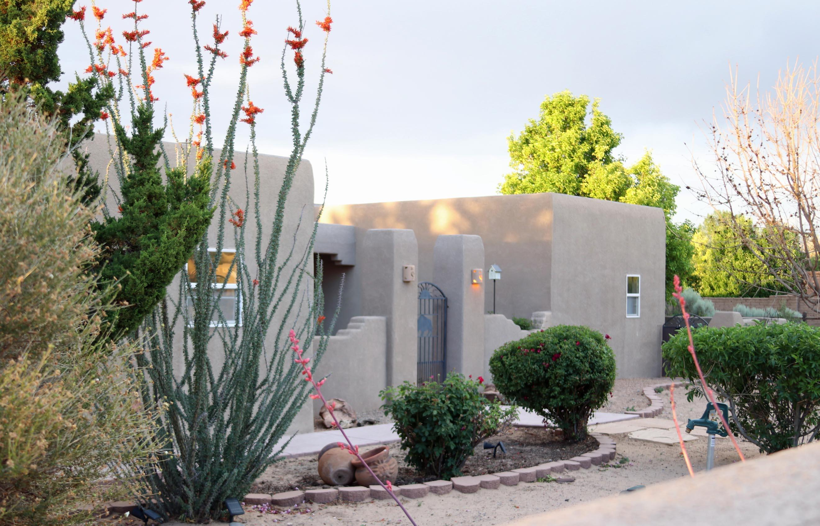 Stunning Corrales Beauty welcomes you w/ a courtyard entrance! Gracious living room w/ vaulted ceilings, vigas, tongue & groove ceilings & corbels. You'll love the cozy Kiva fireplace for those cold winter nights. Chef's delight kitchen w/ granite counter tops, plenty of cupboard space & breakfast bar. Stainless appliances, include a drop-in gas cooktop & Bosch dishwasher. Wonderful multi-gen floor plan. Master is separate from other bedrooms & there's  a possible In-law suite too! Amazing new NE covered patio, complete w/ a kiva fireplace w/ fantastic mountain & city light views! Art studio/office/workshop & sunroom not included in sq. ft.  No water bill (well) No electric bill  (solar.) Rain barrels &new irrigation system. Plenty of parking. It's beautiful! SEE LOSO regarding ALARM.