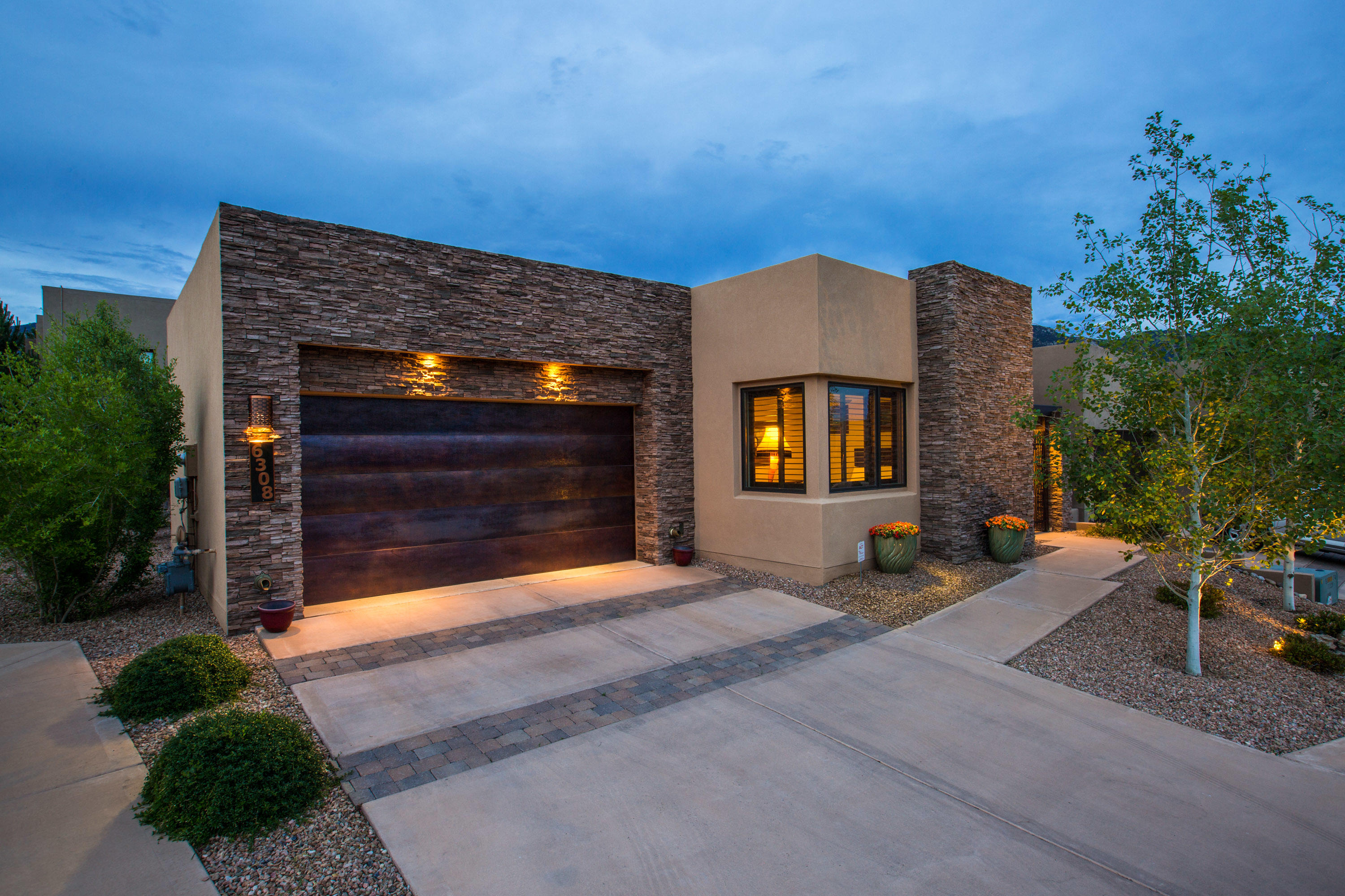 Welcome home to the Legends at High Desert! This Gorgeous Contemporary Twist on a southwest home has been lovingly updated with attention to detail rarely found. Perfectly situated in the Heart of the Gated Community this home is minutes from the finest hiking & biking trails the Foot Hills have to offer. Smart Single Story Floor Plan is great for entertaining. High End Finishes include custom light fixtures, Stacked Stone Fireplace, Alder Hardwood Kitchen Island Top & Range Hood surround. Timeless Wood-Look Tile Floors, Pella Windows & Bosch Appliances. Spacious Owner's Suite boasts private access to Quaint Backyard Patio, Walk-in Shower, Separate Soaking Tub & Dual Vanities. Owner's closet is ''Next-Level'' & Perfect to Showcase your Manicured Wardrobe. Rare opportunity in the Legends!