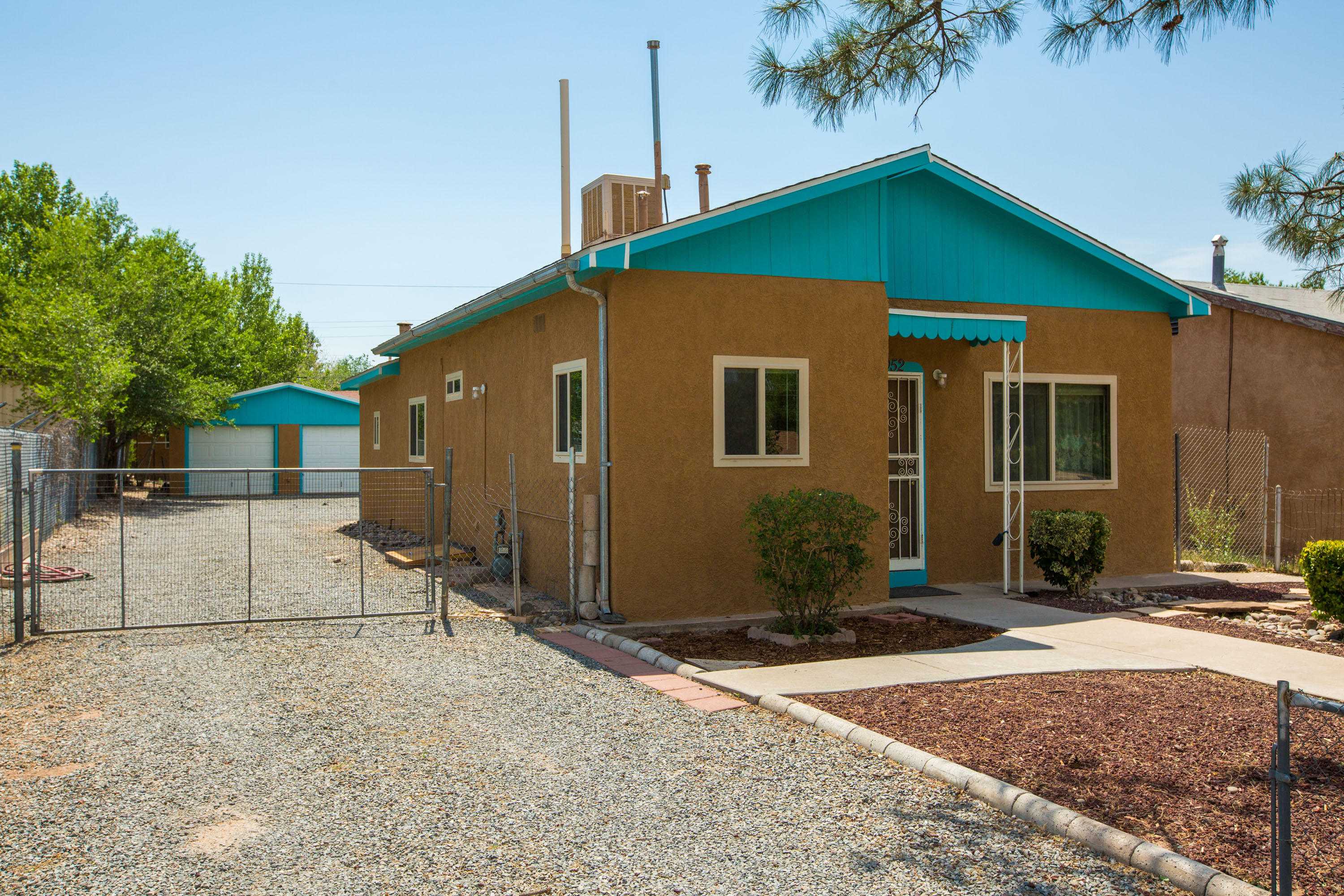 Charming home in the close-in North Valley!  Excellent proximity to Bosque, trails, open space, ditches, Flying Star, and easy access to I-40, Downtown, Old Town, UNM & hospitals.  Recent windows (4-5 years?) roof & sewer line replaced in the past 10 years, hardwood floors, and detached 2 car garage.  This one won't last long - get your offers in by Sunday, 6/27 @ 6pm.  Offers to be reviewed on Monday.
