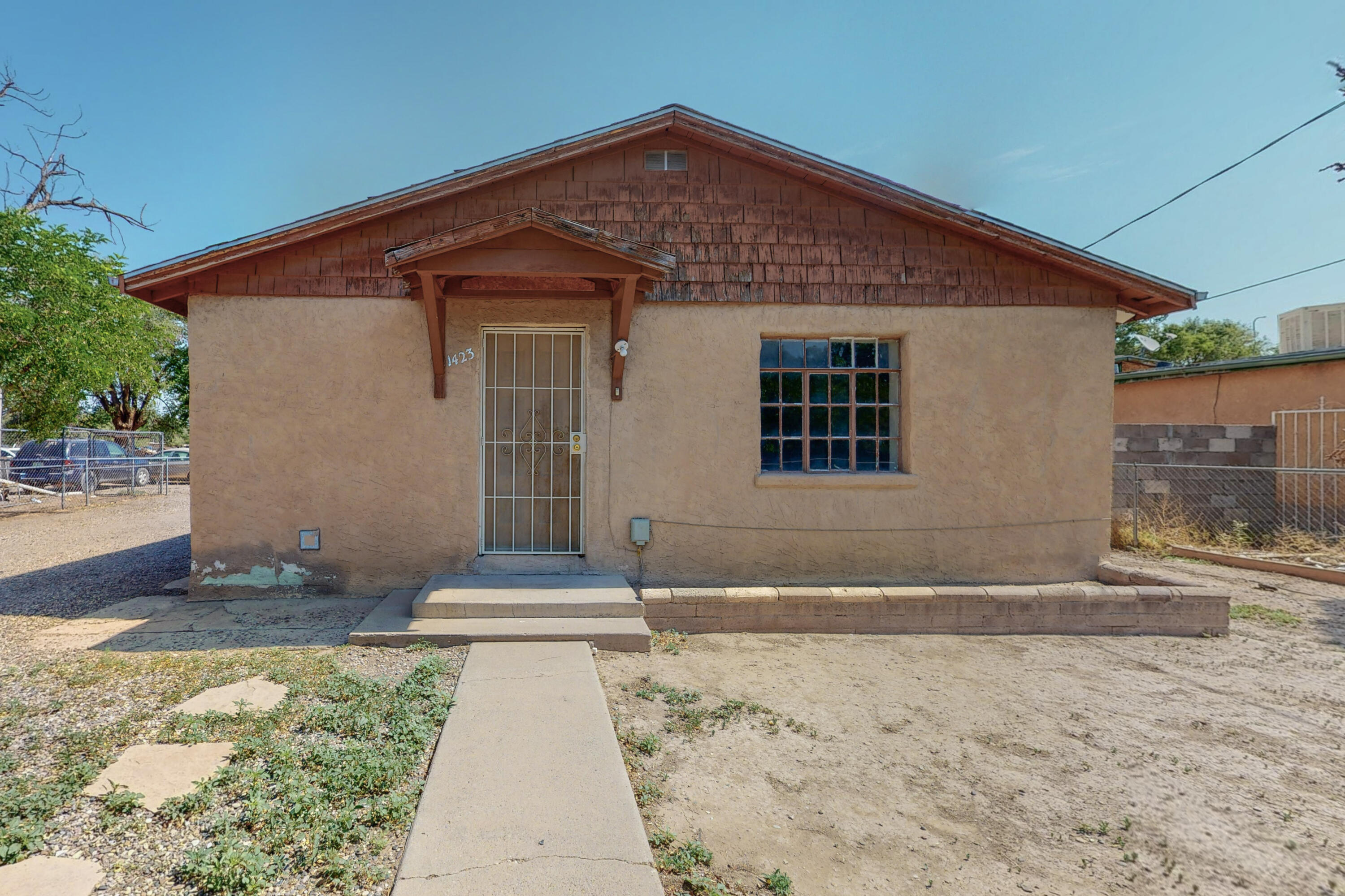 Rare South valley  charm with so much potential. This homes sits on an oversized lot with plenty of space for parking with a one car garage/shop. 2 Bedrooms, One full bathroom.