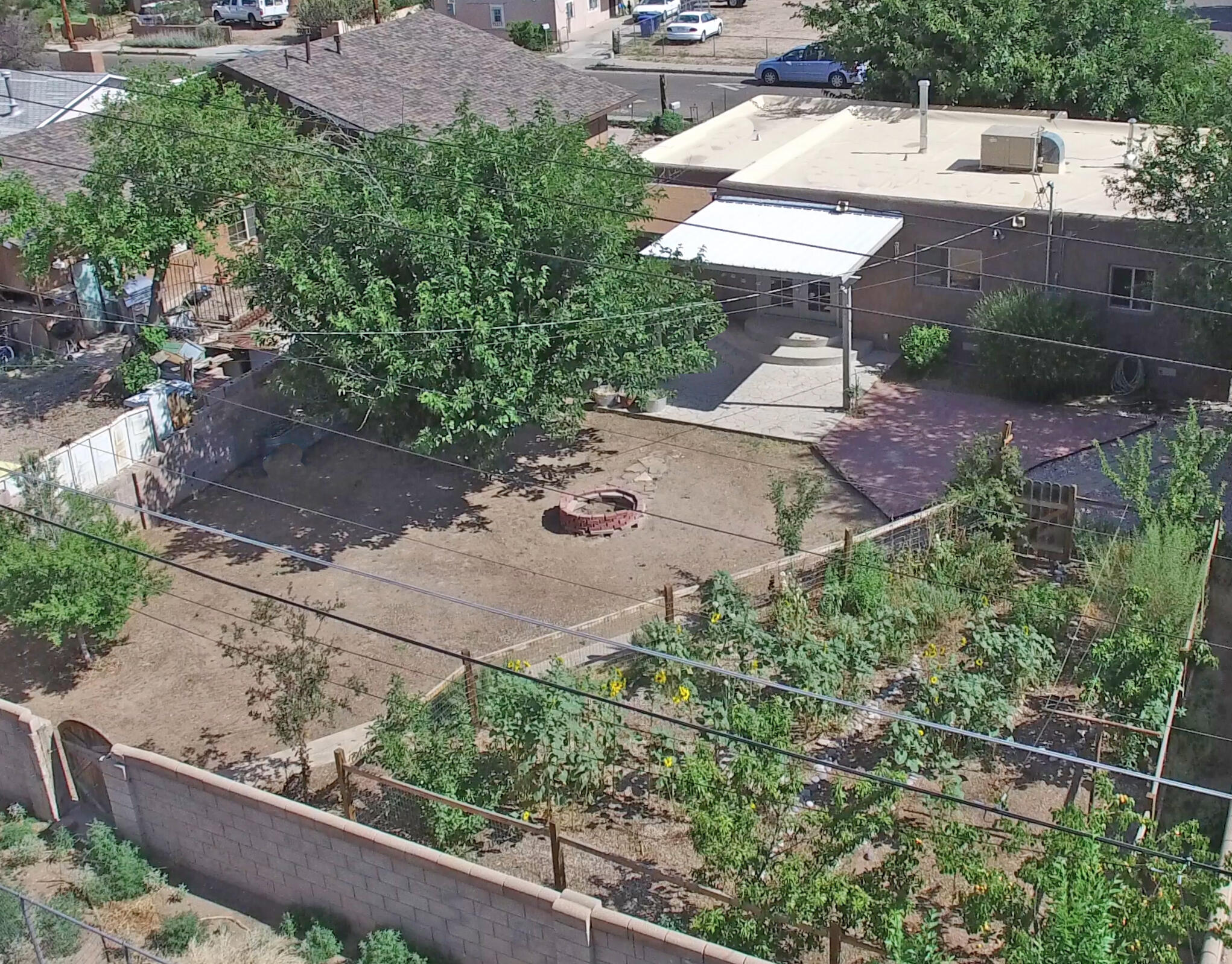 This wonderfully light and bright charming 3 bedroom, 2 bath home in a well-established area of the near north valley is an ideal ''starter'' or ''start over'' home. Remodeled 3 years ago with almost everything updated and/or replaced. Hardwood floors in living and bedroom, easy care tile in kitchen and baths.  Generous kitchen has Whirlpool stainless steel appliances, a deep stainless steel sink topped off with a reverse osmosis water filtration system for great tasting clean water on demand!  Large windows provide ample natural light throughout.  Closet space for this age of home is generous. French doors lead from master bedroom onto covered patio and then into spacious back yard full of several fruiting trees and gorgeous sunflowers. Garden on drip system for ease-a gardener's delight!