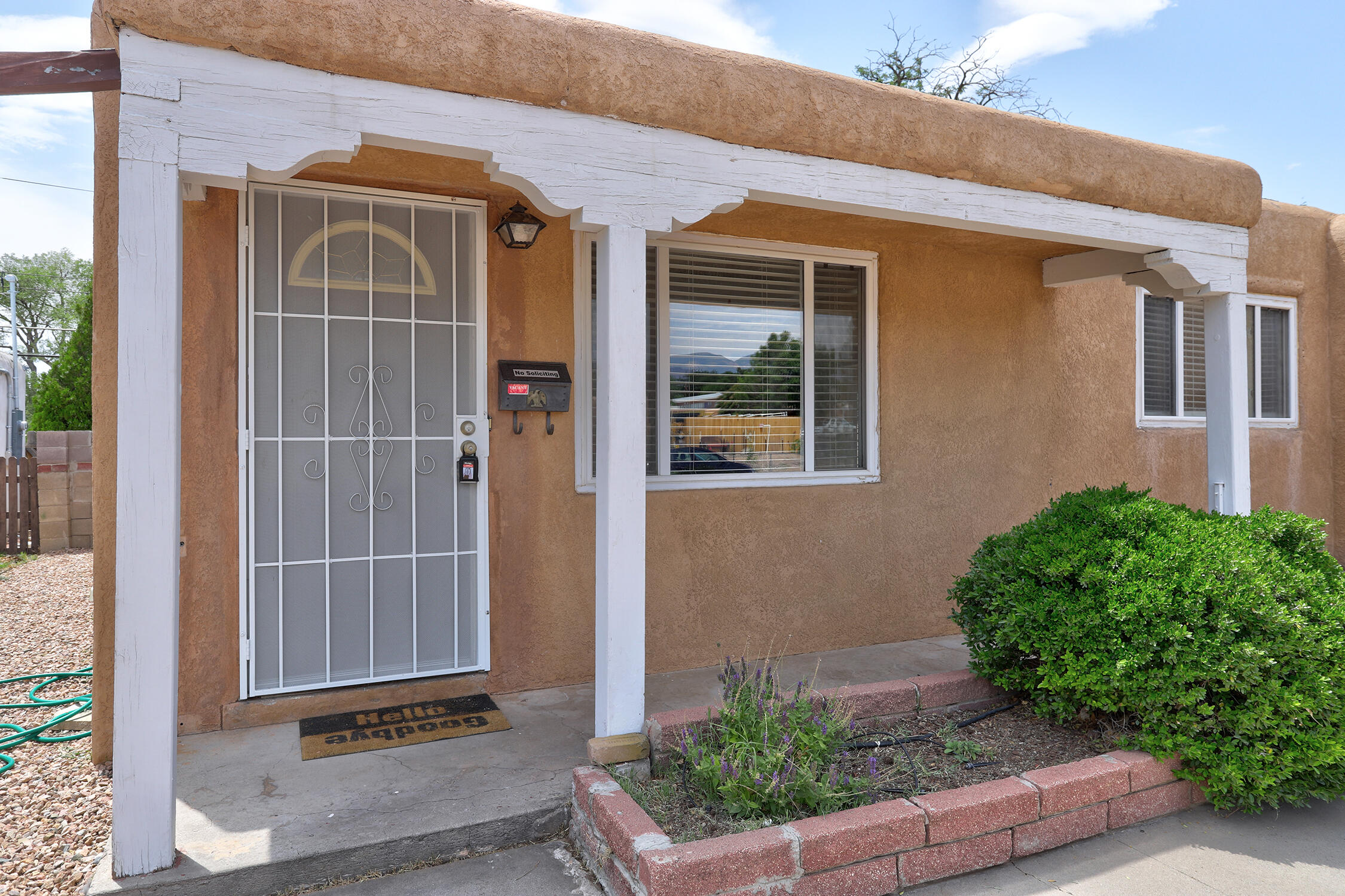 Pueblo style HOME with great curb appear is Ready for a new owner! There are 3 Bedrooms, 2 Baths, 2 Car Garage PLUS 2 Spacious Living Areas and Dining Room!! Cooks Kitchen with tile floors and pantry. Baths are updated! All Bedrooms are nice size. Family Room is open to Walled Backyard with open patio.  Be the one to call this one HOME!!