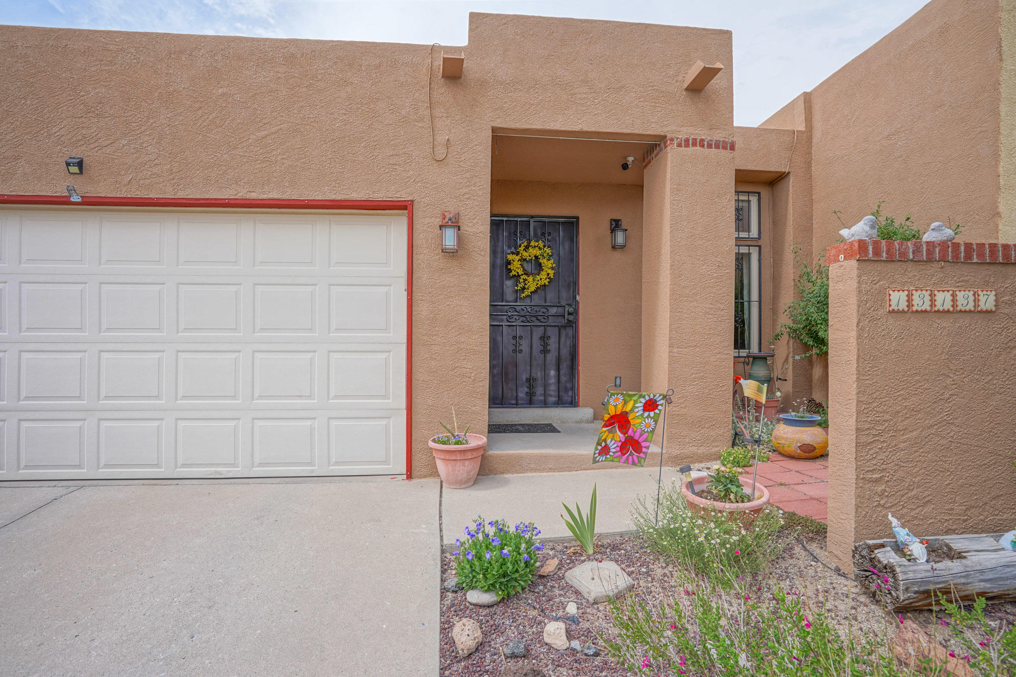 Single story Townhome(no HOA) East of Tramway close to Foothills Trails and Tramway path.  Convenient to Sandia Lab, KAFB, shopping and schools.  11' Ceiling in Great Room with clearstory window and fireplace.  Skylights in Kitchen,  both Bathrooms and Office/Flex area for light, bright floor plan.  Refrigerated Air!  Updated vinyl windows.  Covered patio, pergola and separate area with Hot tub in backyard. Cozy front patio courtyard.